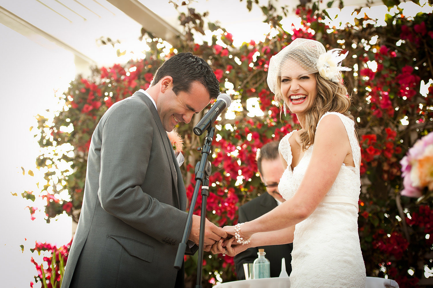 Bride laughing at ceremony with groom