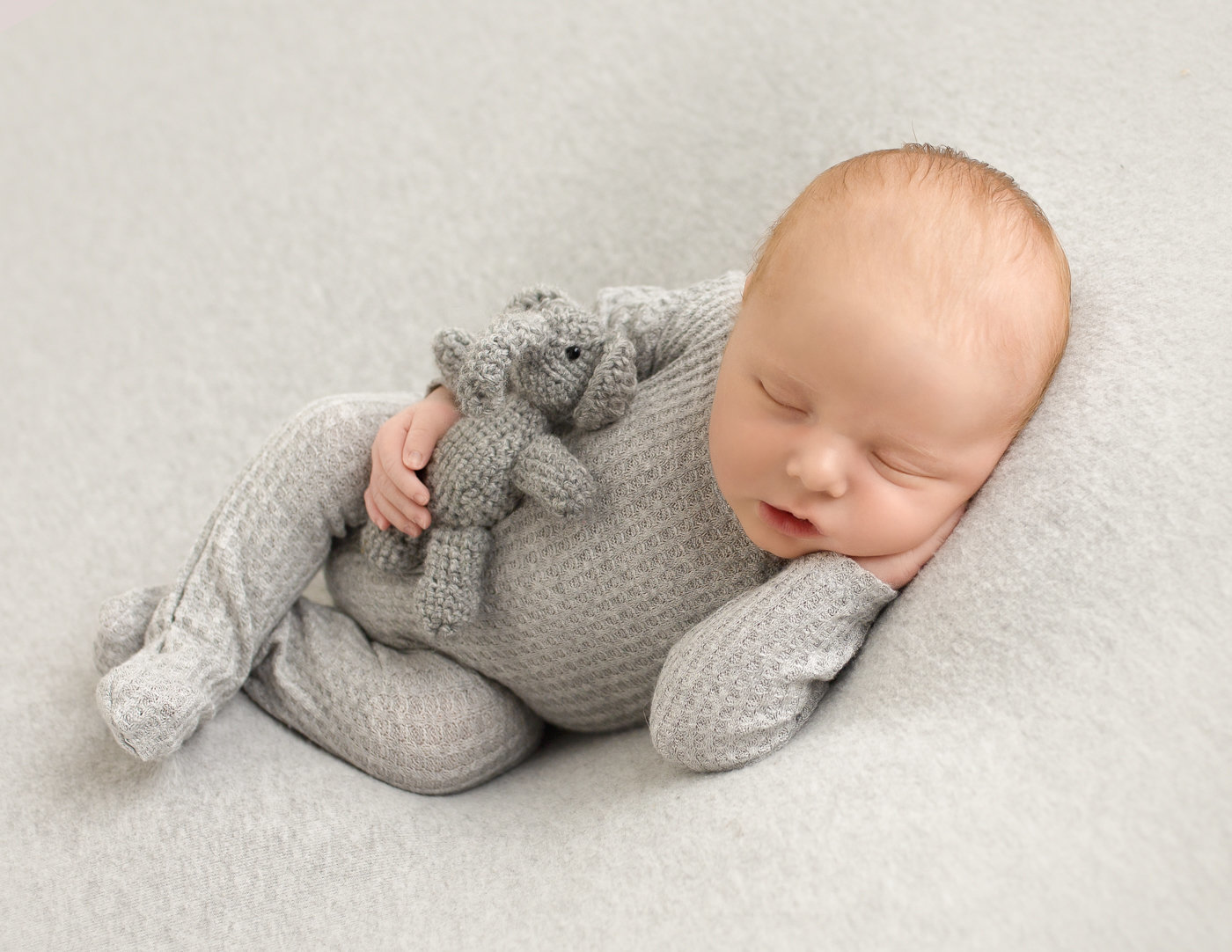 Precious newborn boy posed in our Rochester, Ny studio.