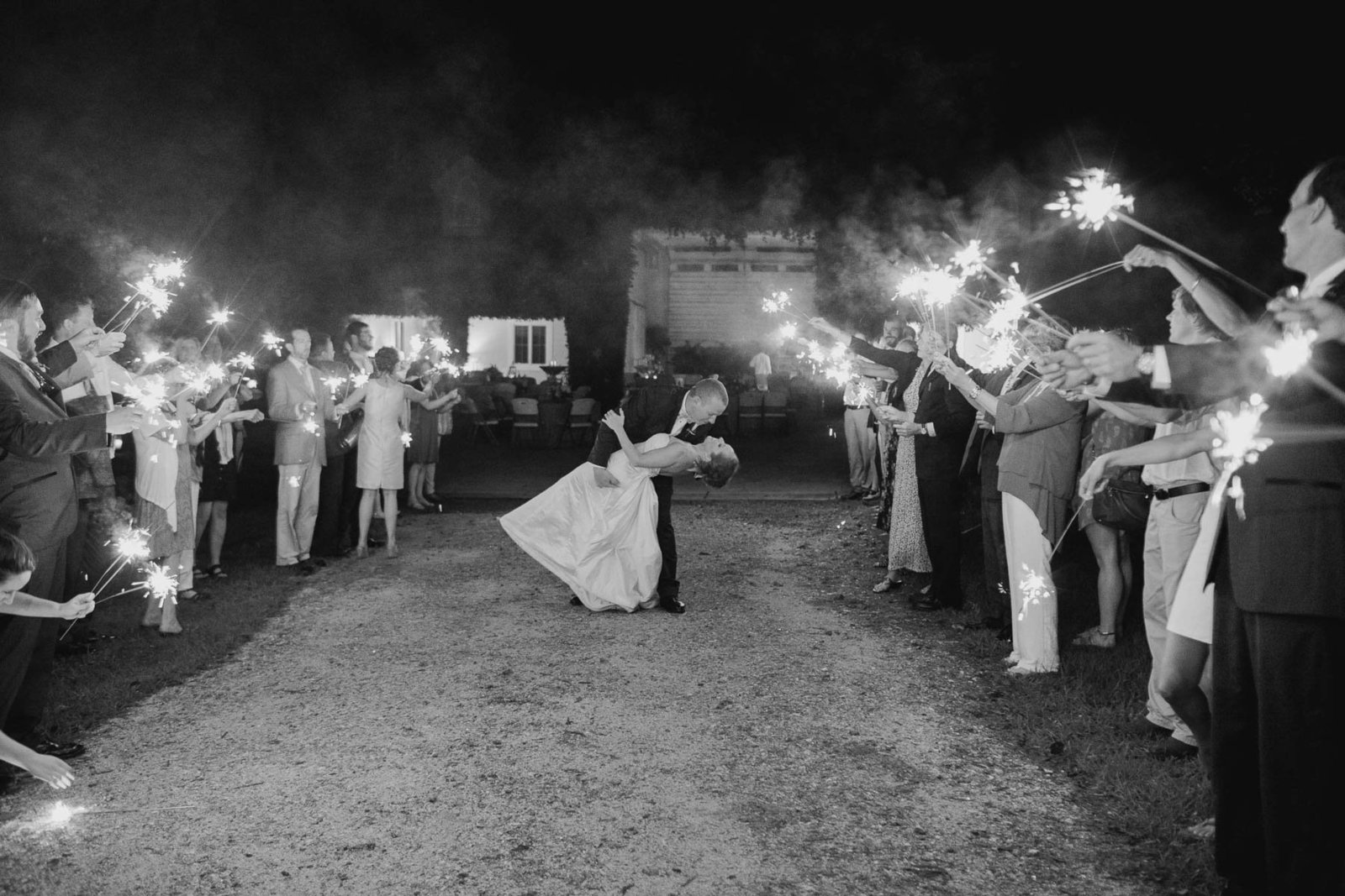 Bride and groom have sparkler exit, Old Wide Awake Plantation, Charleston, South Carolina