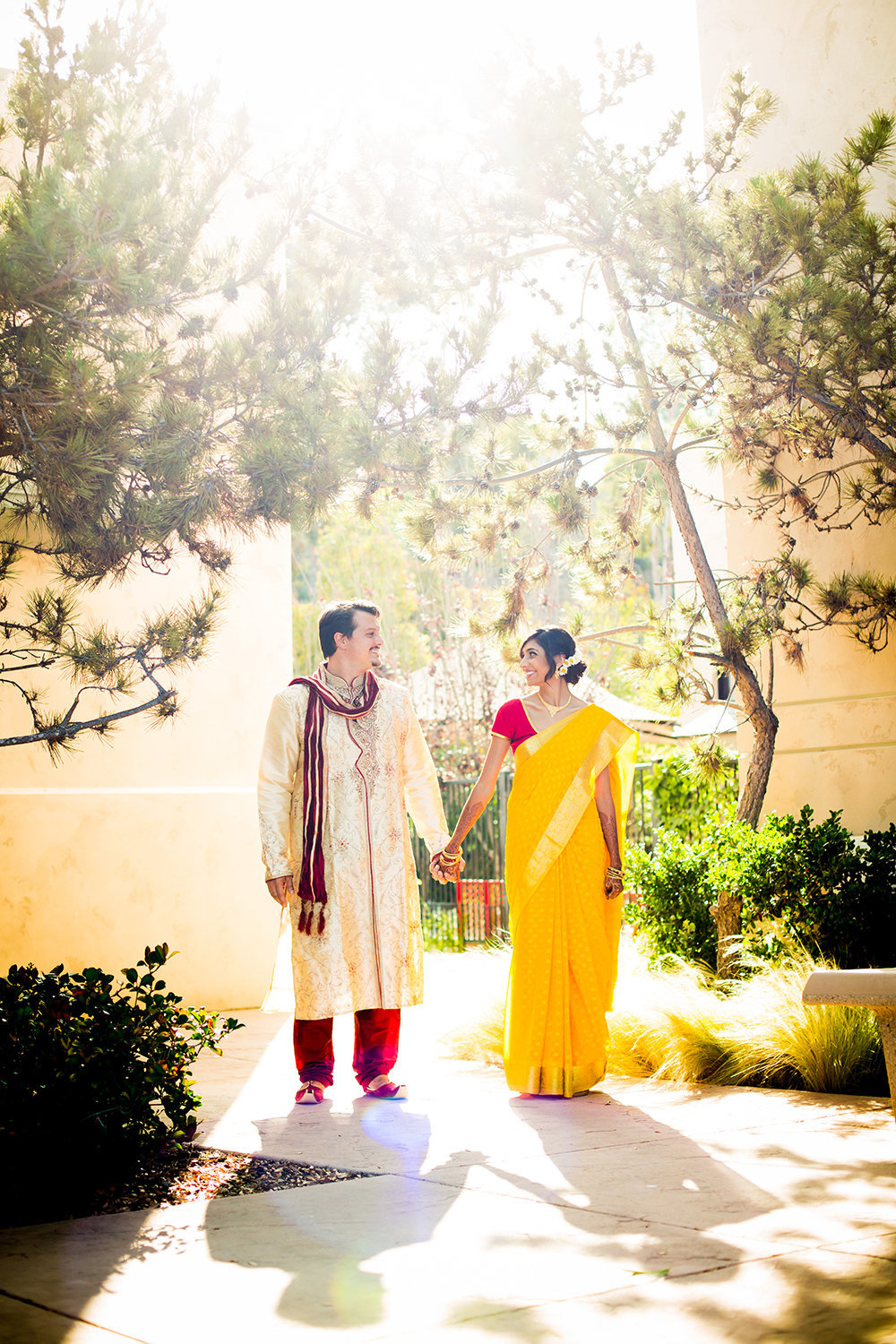 Cute Pose for Indian Hindu Couple with Bride in Sari and Groom in Sherwani