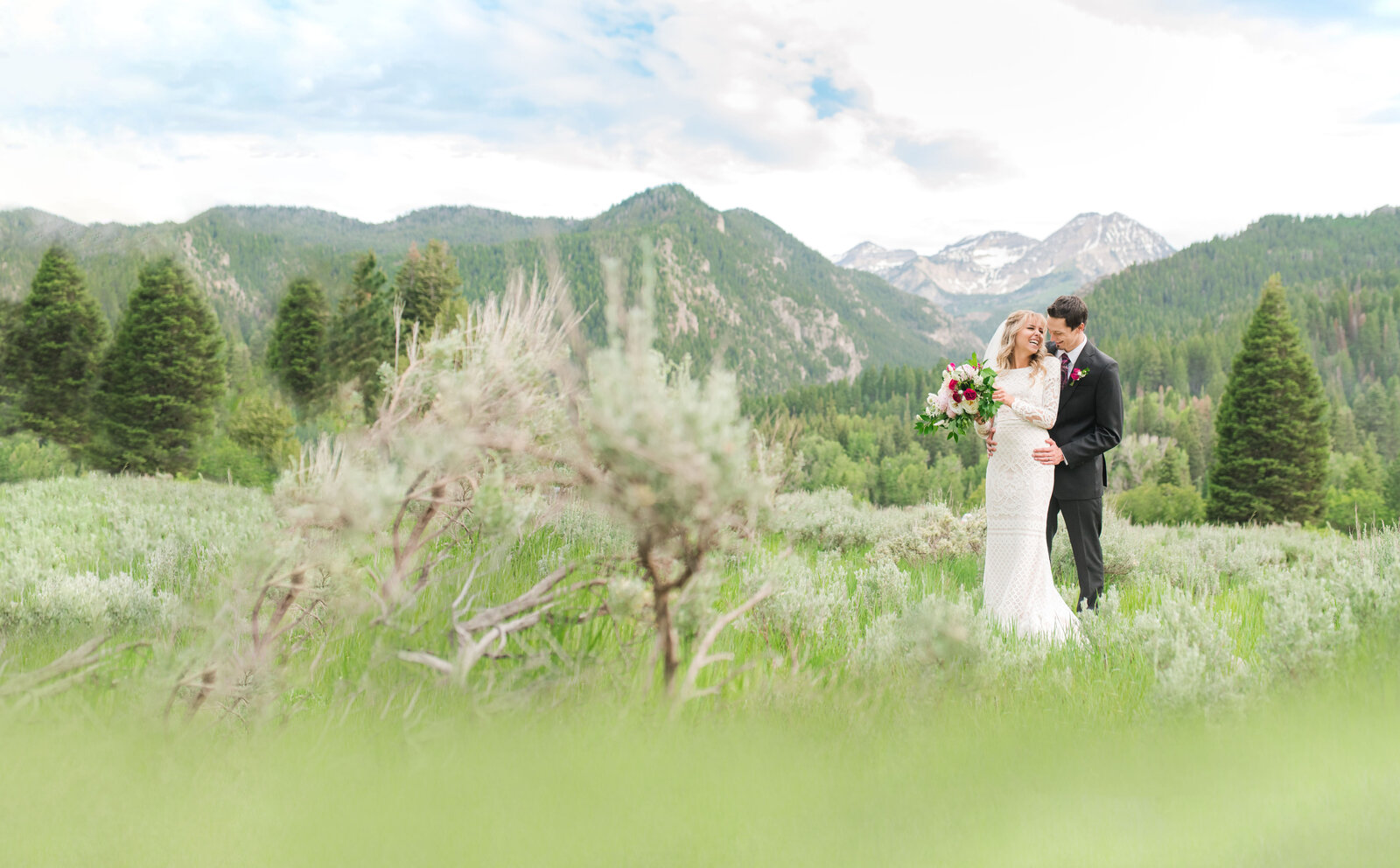 Bride and groom at Tibble Fork with Mount Timpanogos in the background
