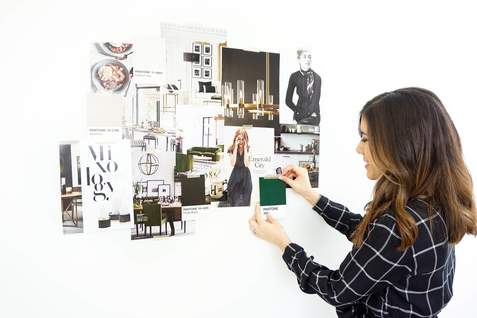 Woman placing images on wall