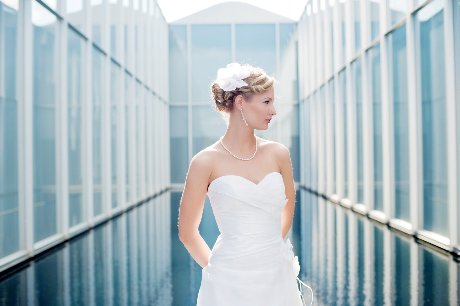 bridal portrait in front of blue pool at nc museum of art