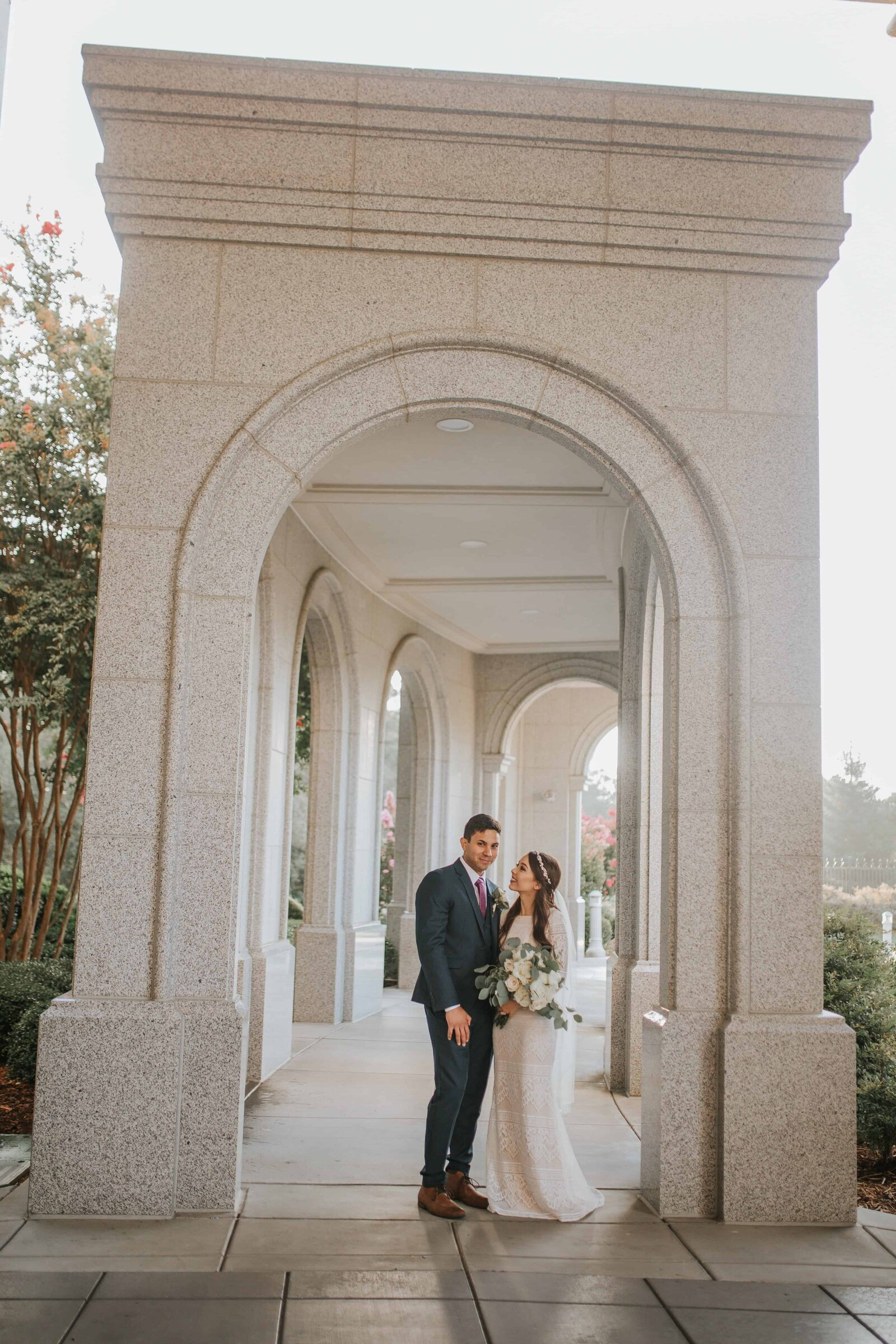 bride and groom under arch way in Chattanooga Tennessee