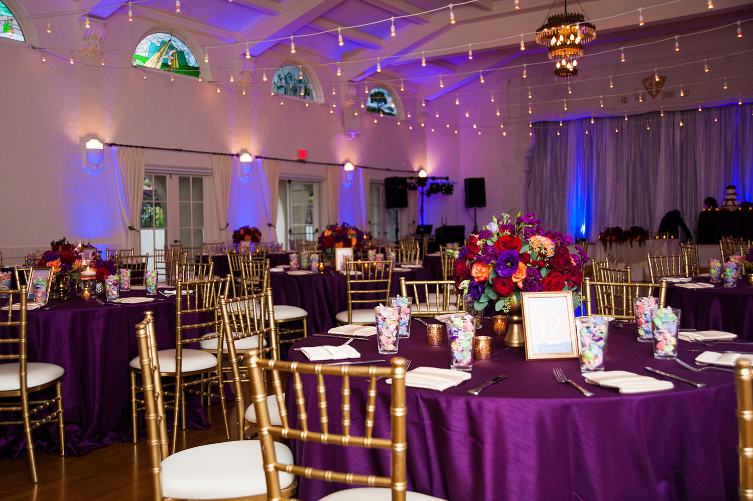 reception room with purple tables