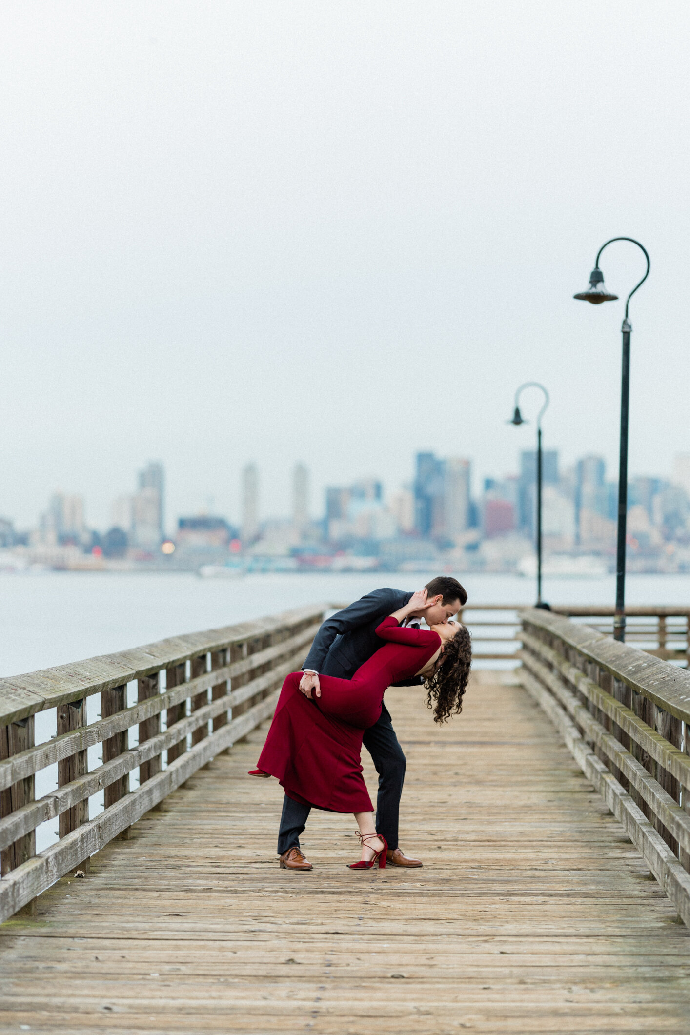 Couple kissing and hugging in romantic photo from Alki Beach, top locations for engagement photos in Seattle