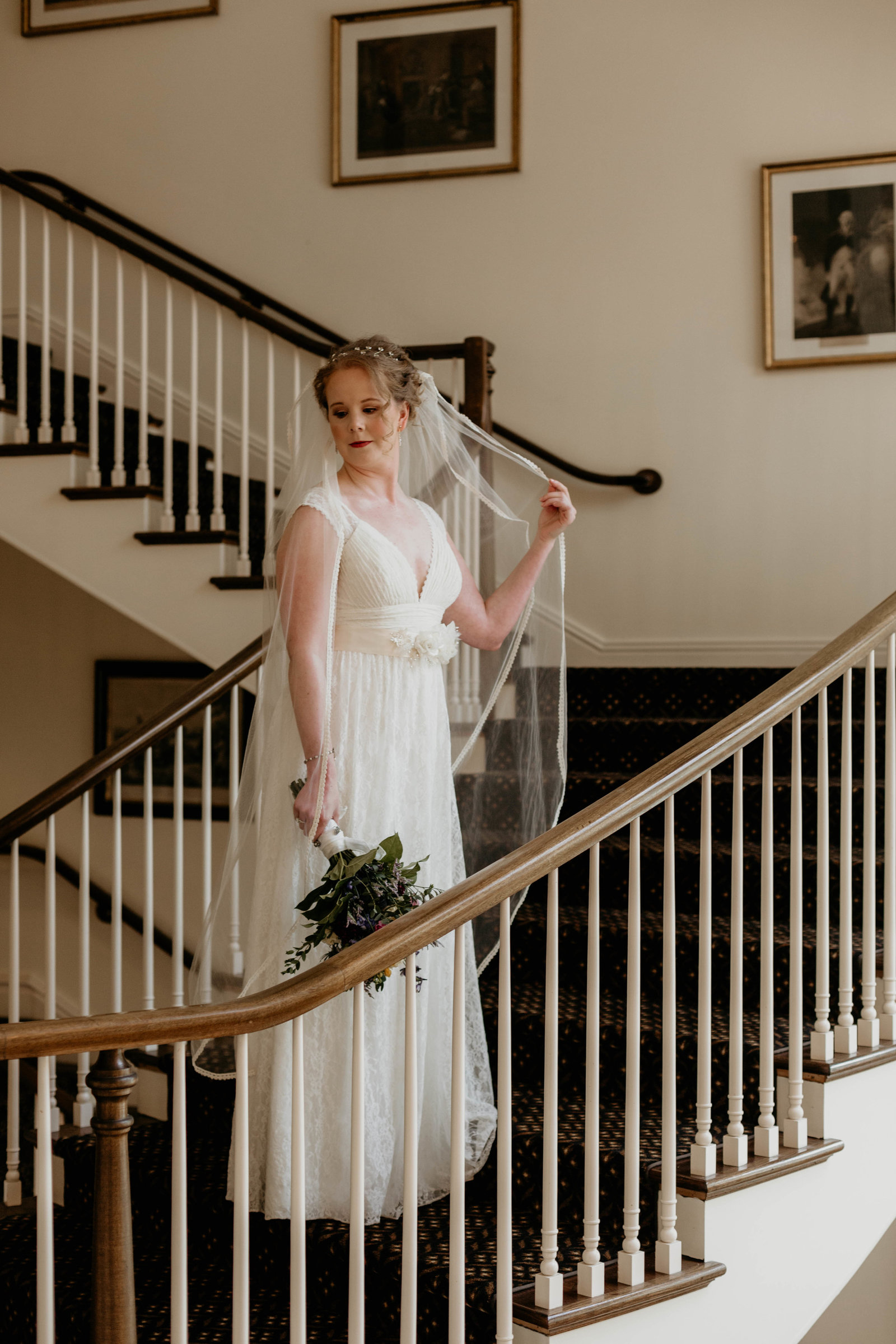 Bridal portrait on the stair case at Avon Old Farms Hotel in Avon, Connecticut.