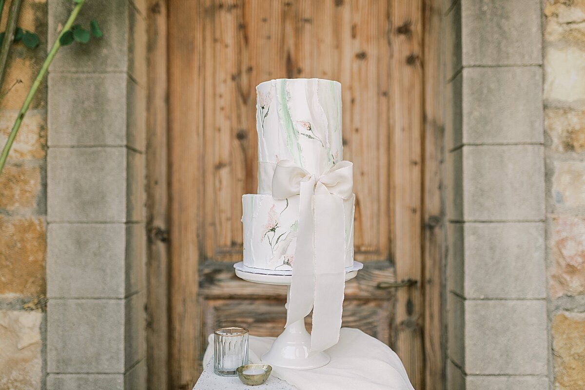 White Wedding Cake Display with watercolor florals painted on