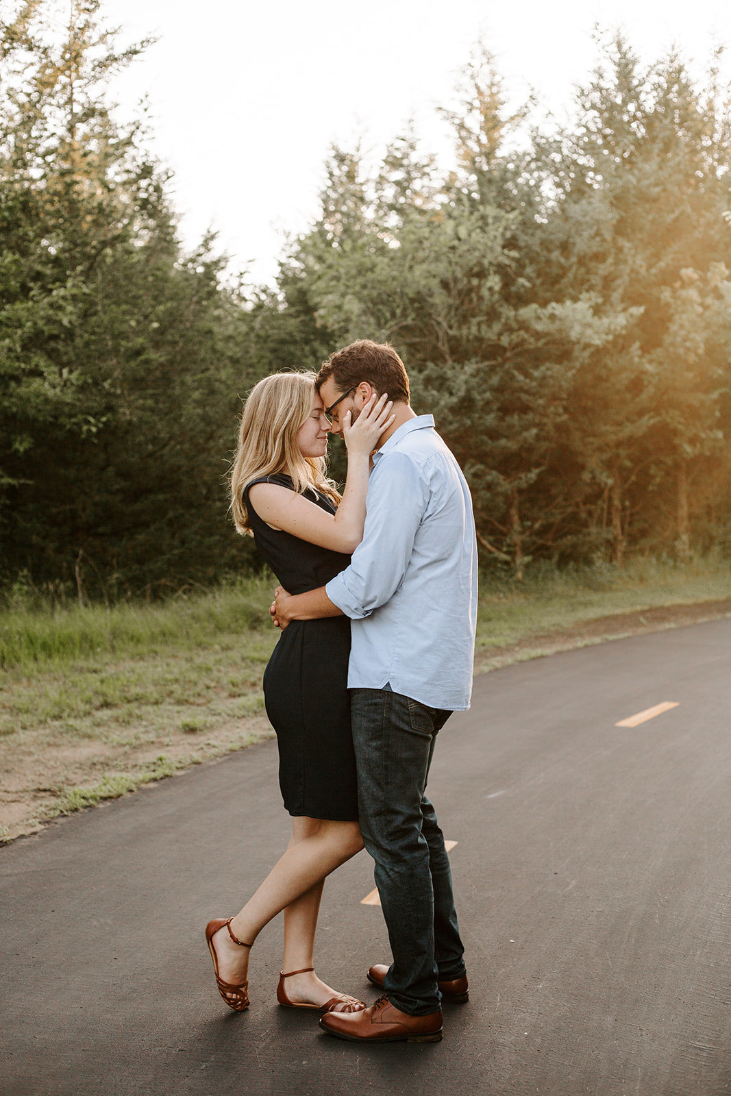 Couple with their arms around each other on a path during their Minneapolis engagement session