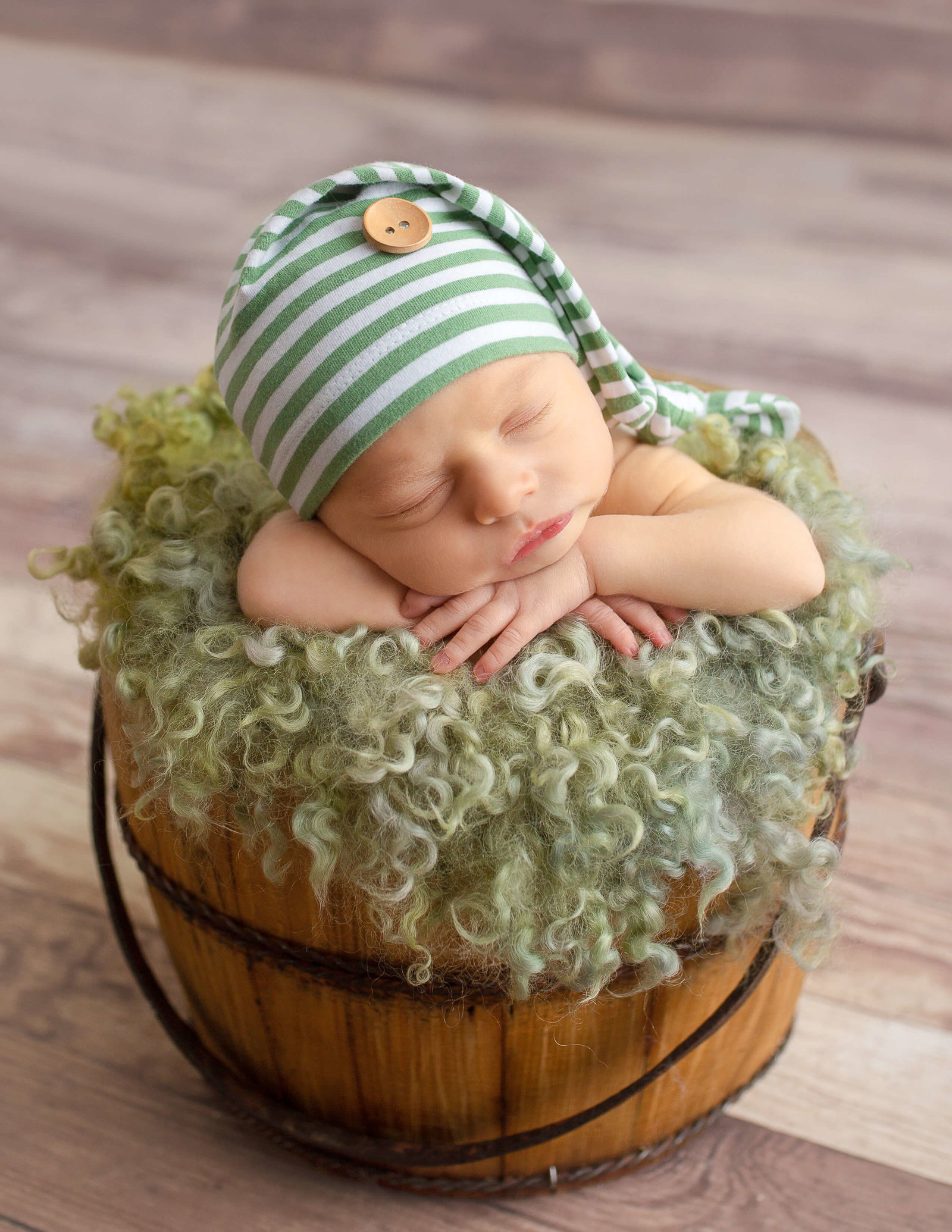 Cute newborn posed at our Rochester, NY studio.