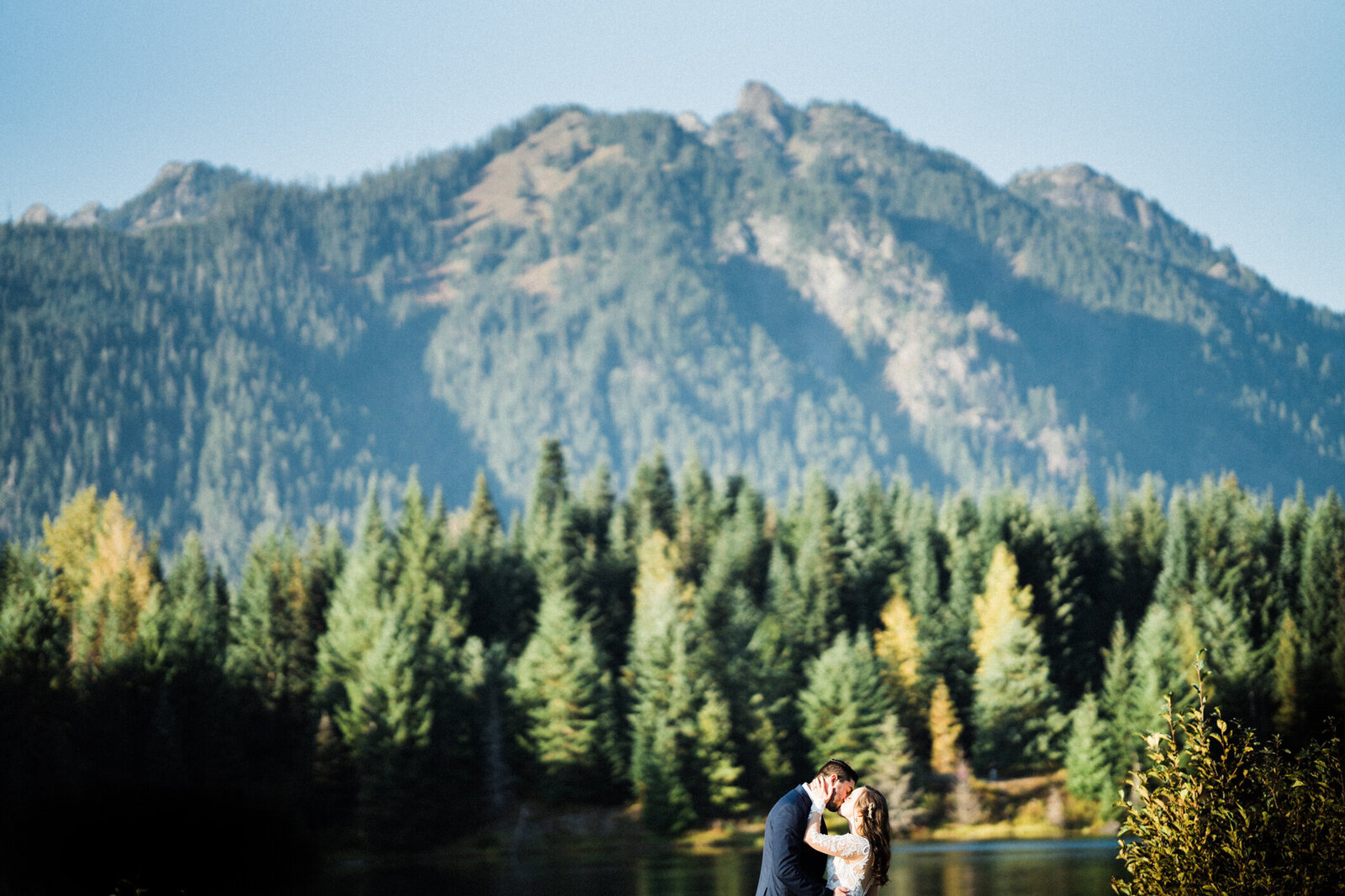 Wedding photographers love the fir trees at Gold Creek Pond, best location for engagement photos in seattle