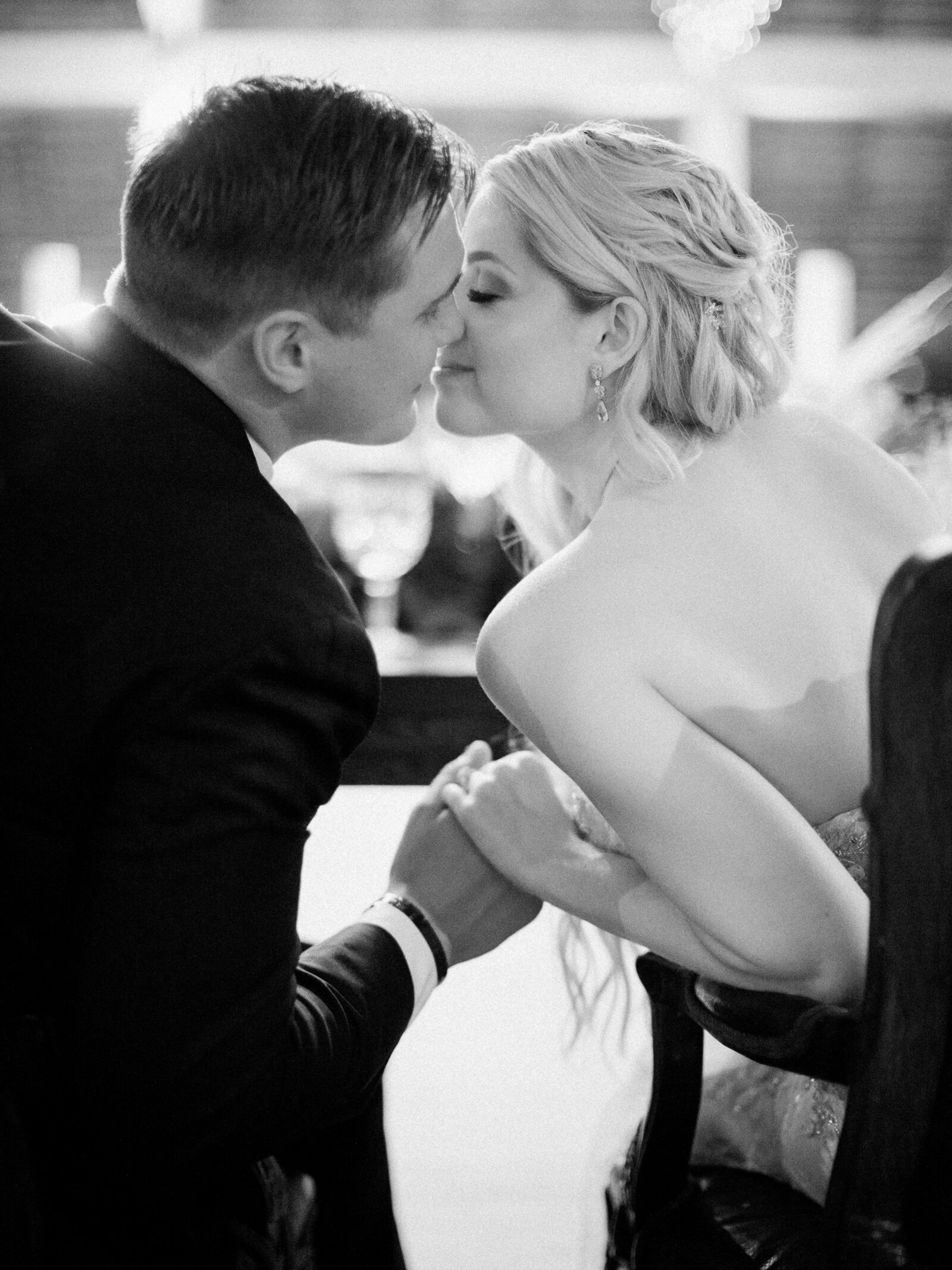 Bride and Groom kissing during Reception