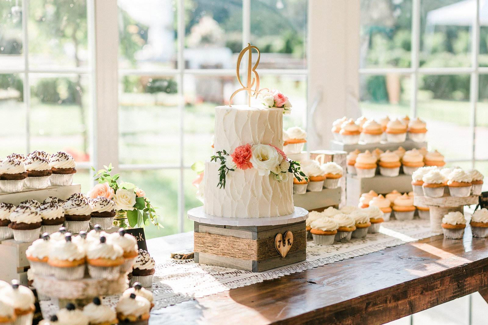 Country style three tier white wedding cake on wood box