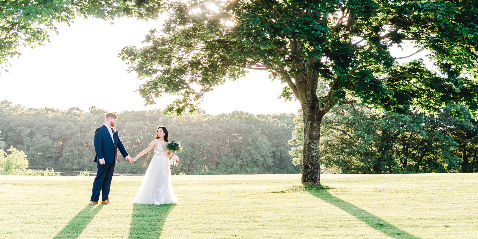 Bride and groom walk in sun at Pawtucket Country Club