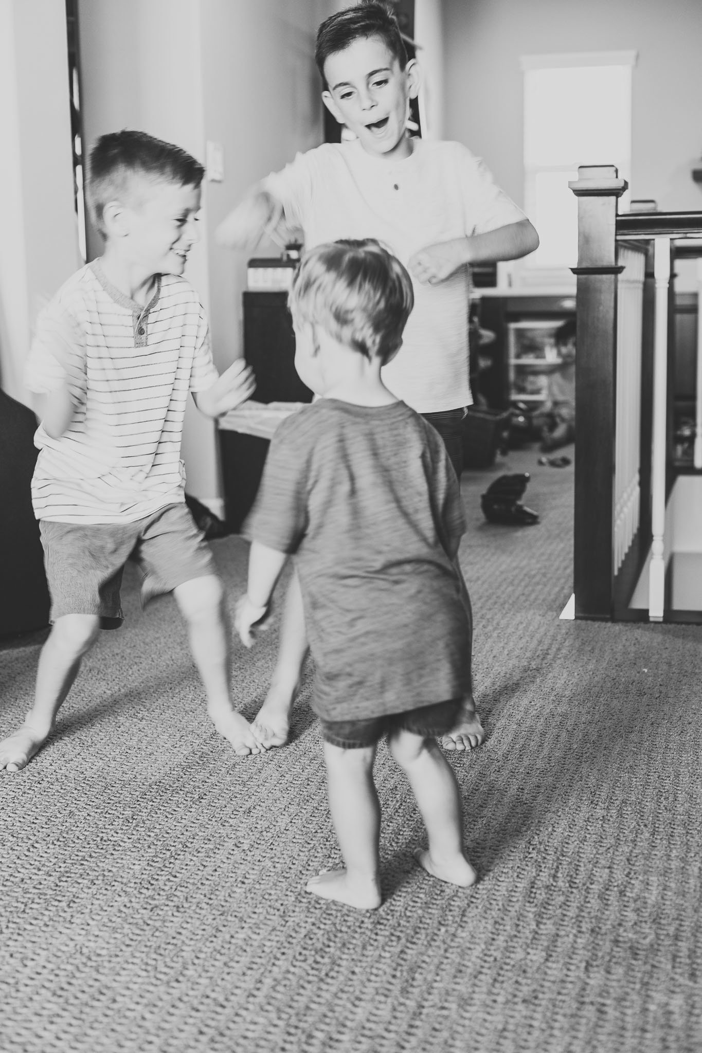 Oahu, Hawaii Lifestyle Photographer - Lifestyle Photography - Brooke Flanagan Photography - Brothers dancing in Black and White