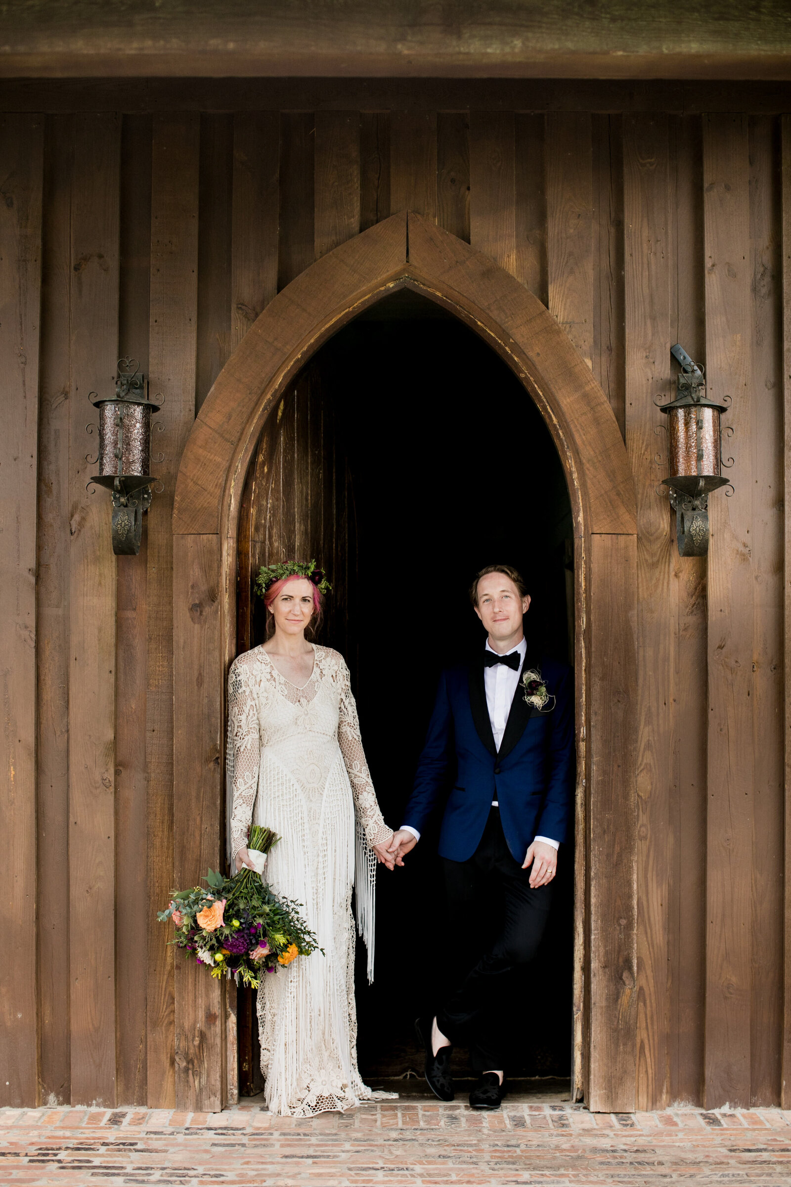 bohemian couple at barn door