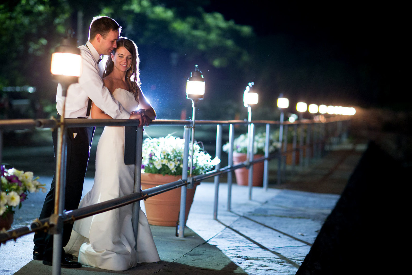 bride and groom outside Glen Island Harbor Club at night