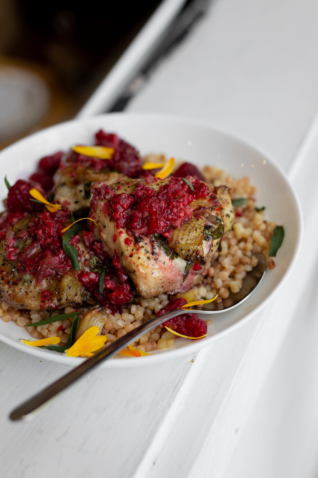 chicken - cous cous- raspberry sauce