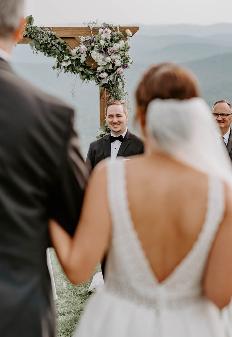 Bride walking down aisle and groom first look in Boone Wedding NC