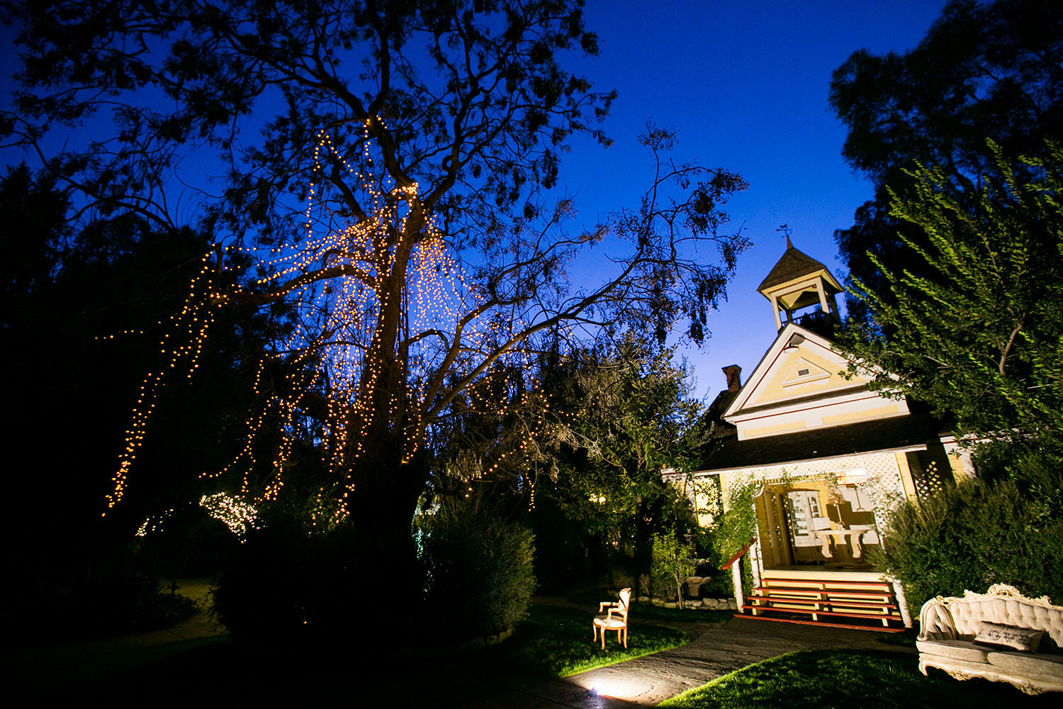 Twin Oaks Schoolhouse lit up at night