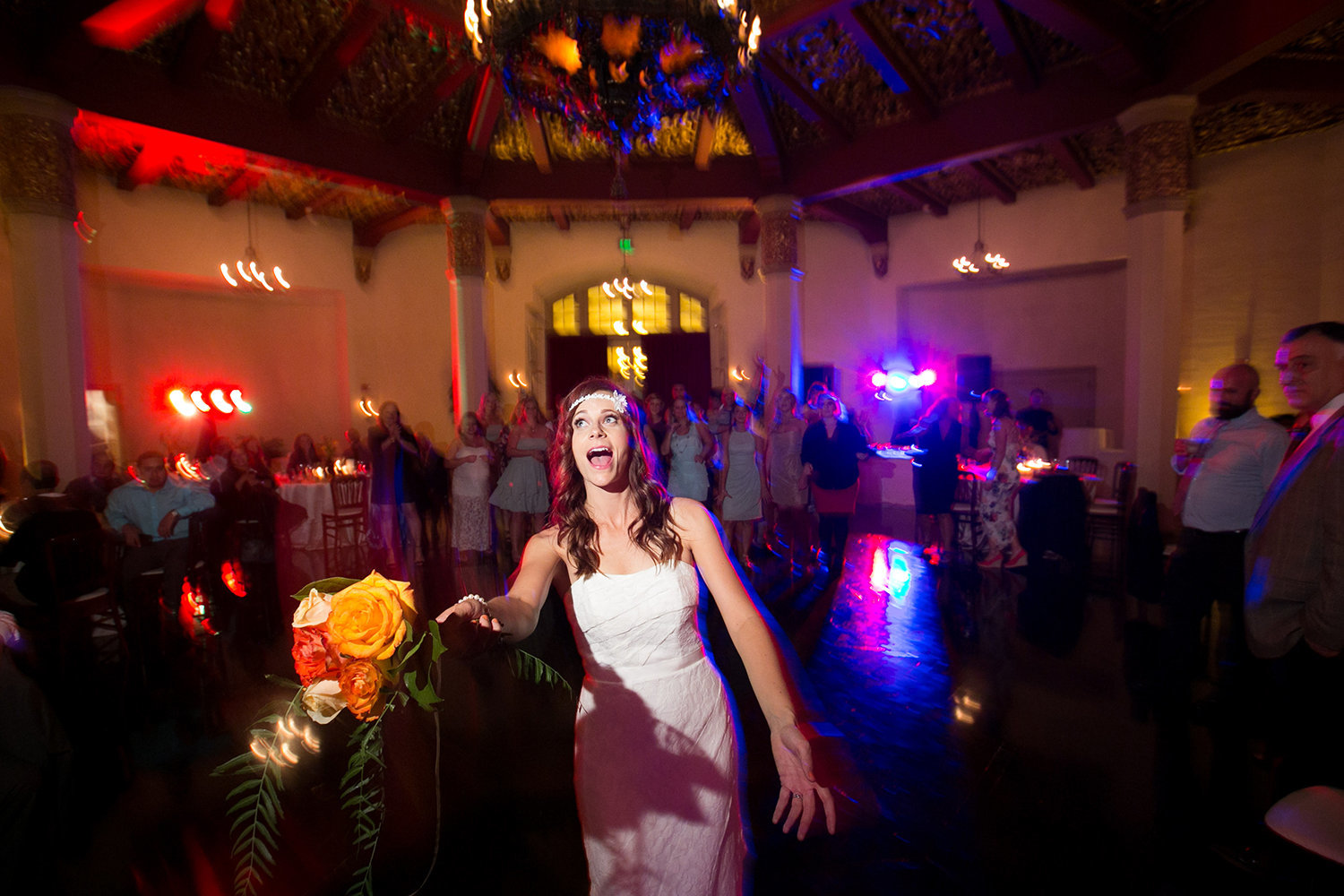 Bouquet toss at a wedding reception