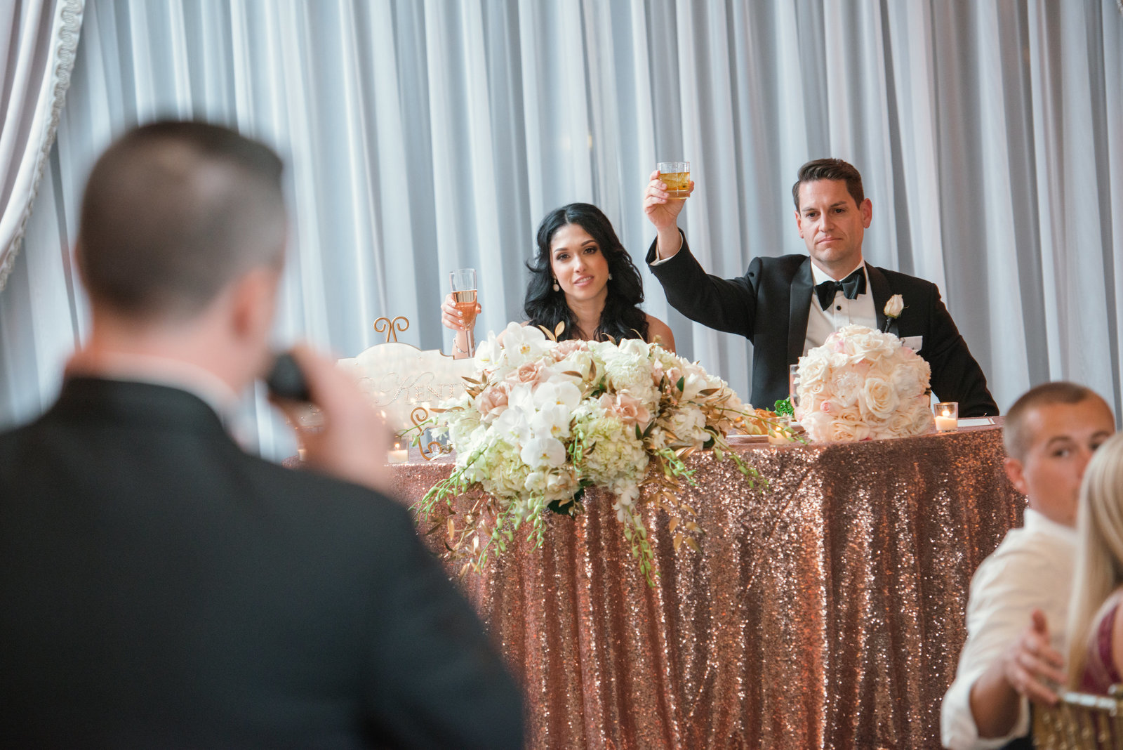 Bride and Groom toasts at Glen Cove Mansion