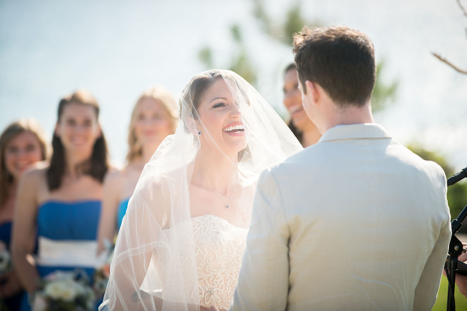 Bride laughing during her vows at a wedding in Seagrove Park Del Mar
