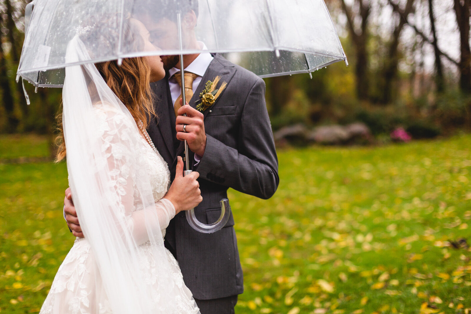 rainy wedding portraits with bride and groom and clear umbrella ohio