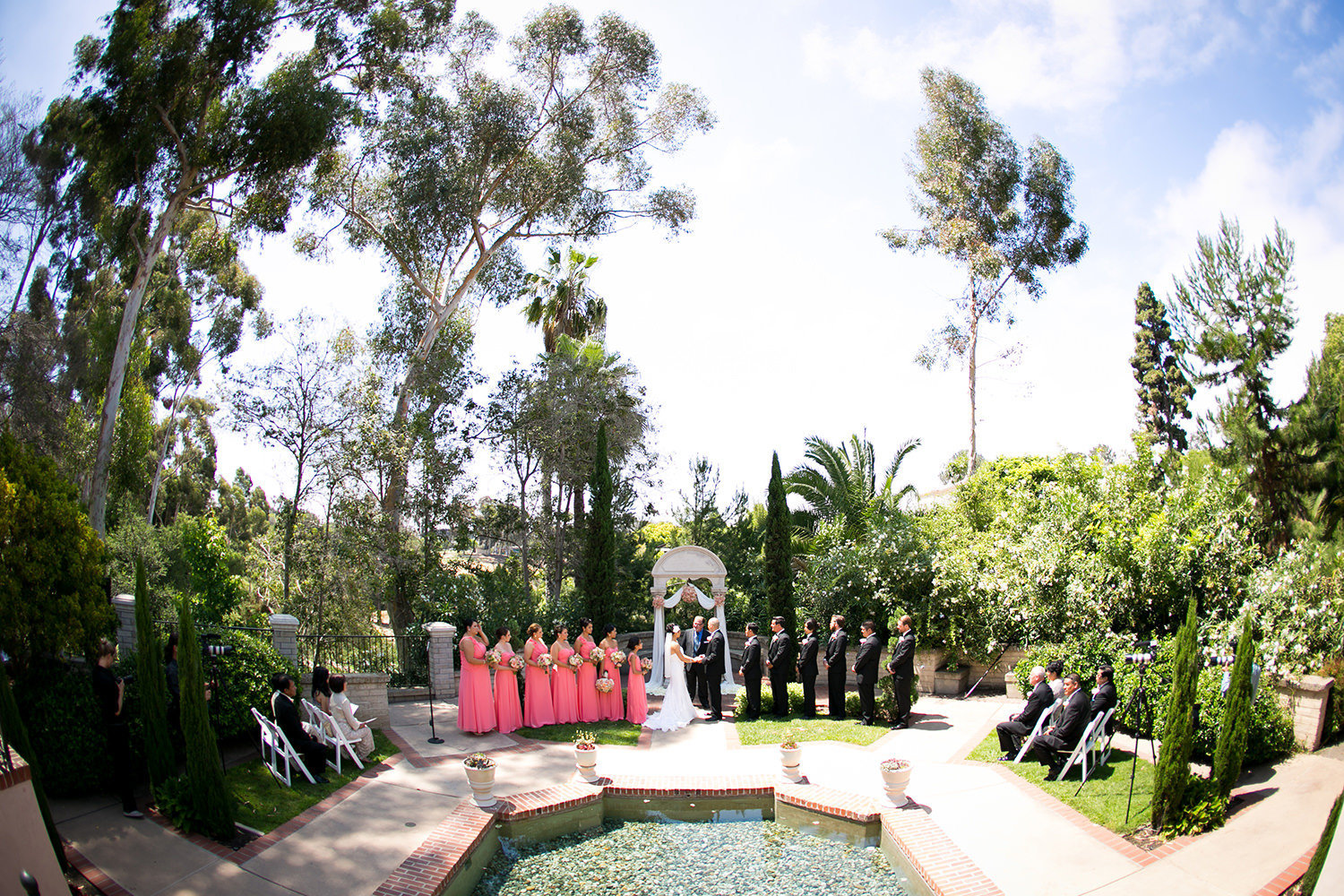 bride and groom at ceremony wishing well the prado