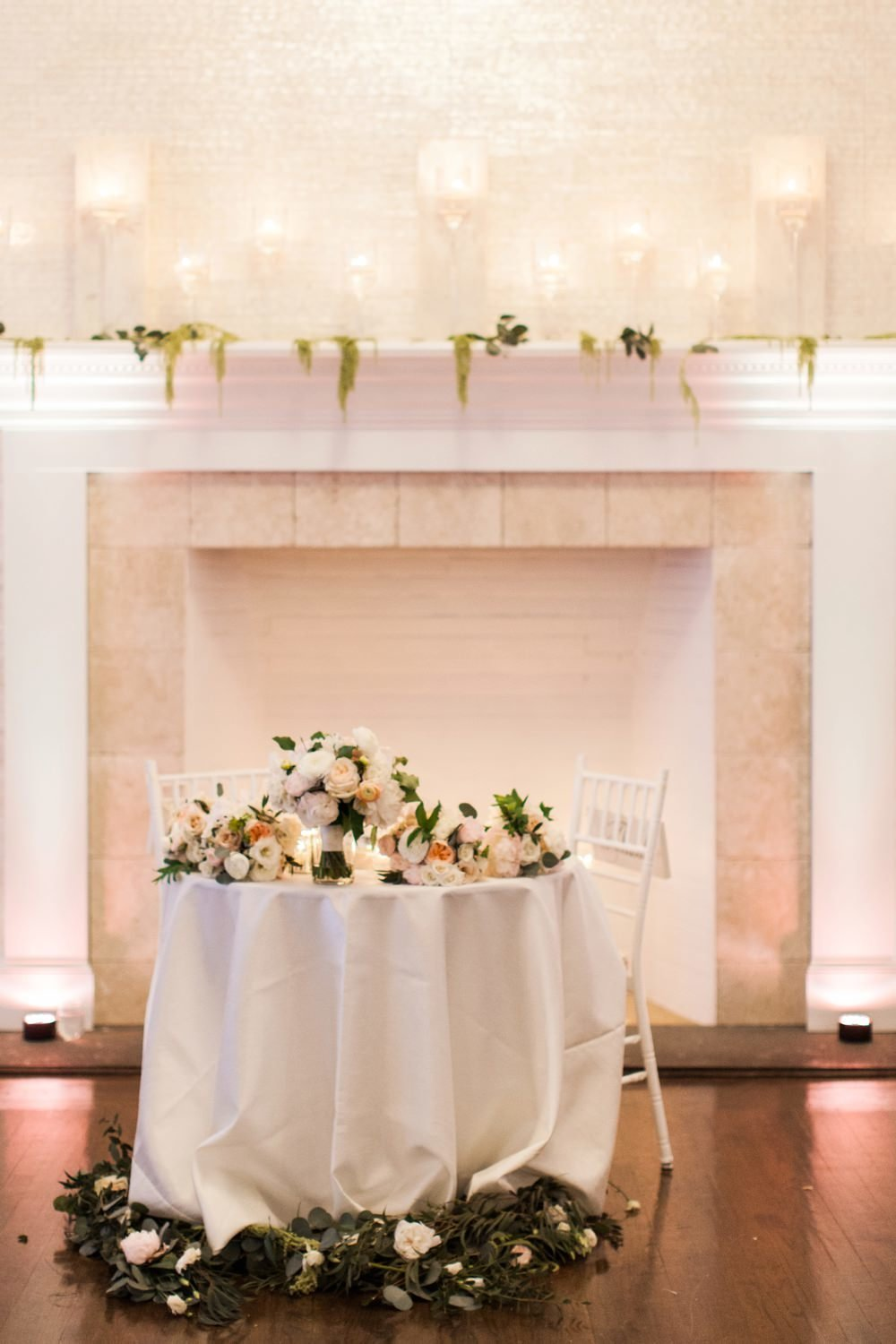 Modern spring wedding at Belle Mer in sweetheart table at Belle Mer in Newport RI with yellow, ivory and blush