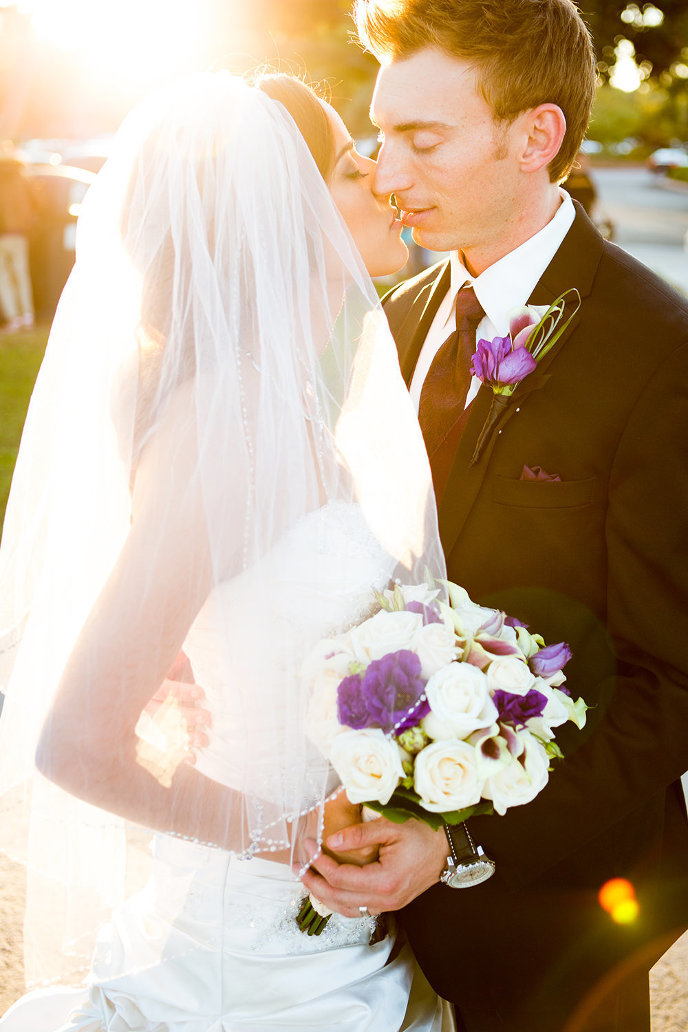 Romantic couples portrait with a bright lens flare