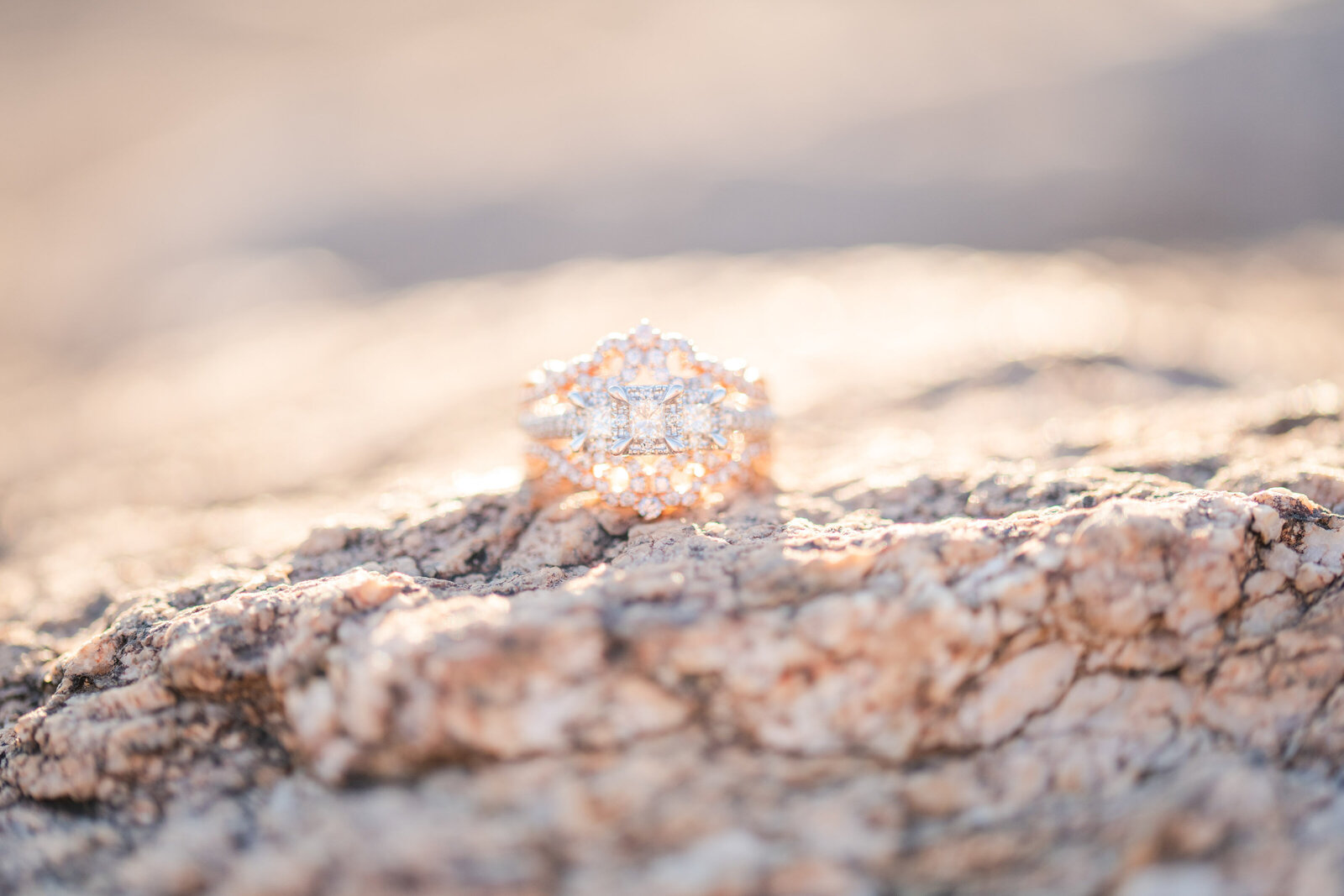 intricate antique style engagement ring on stone