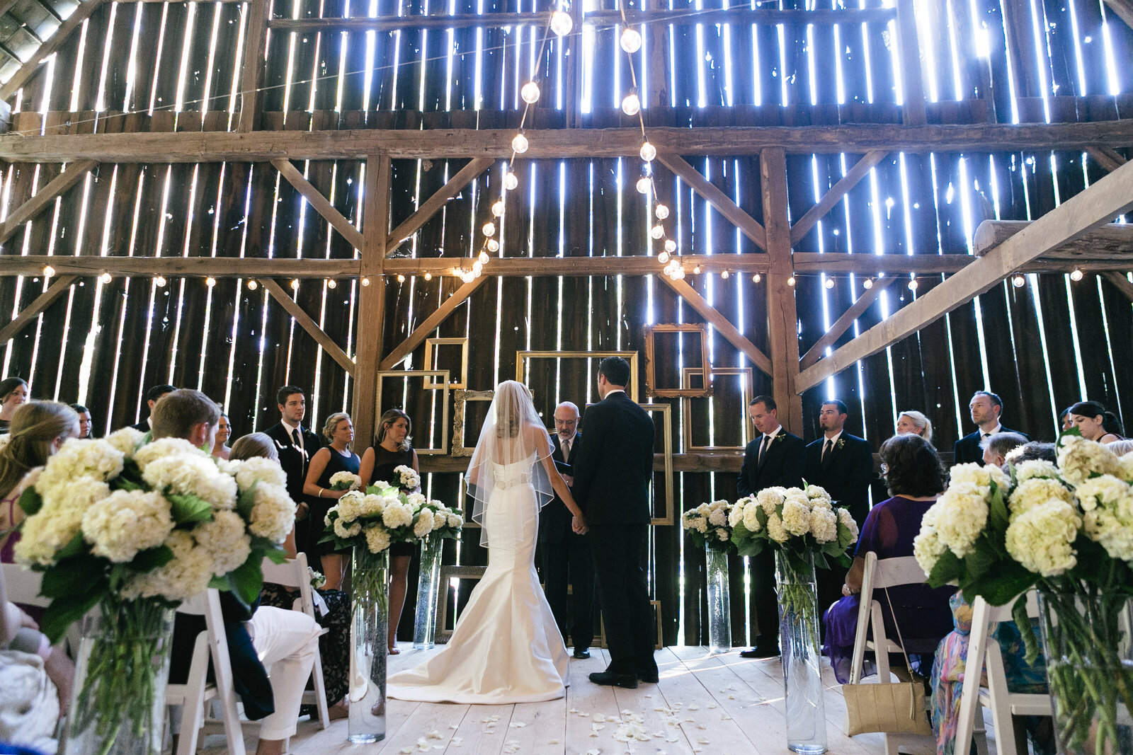 bride and groom ceremony in barn