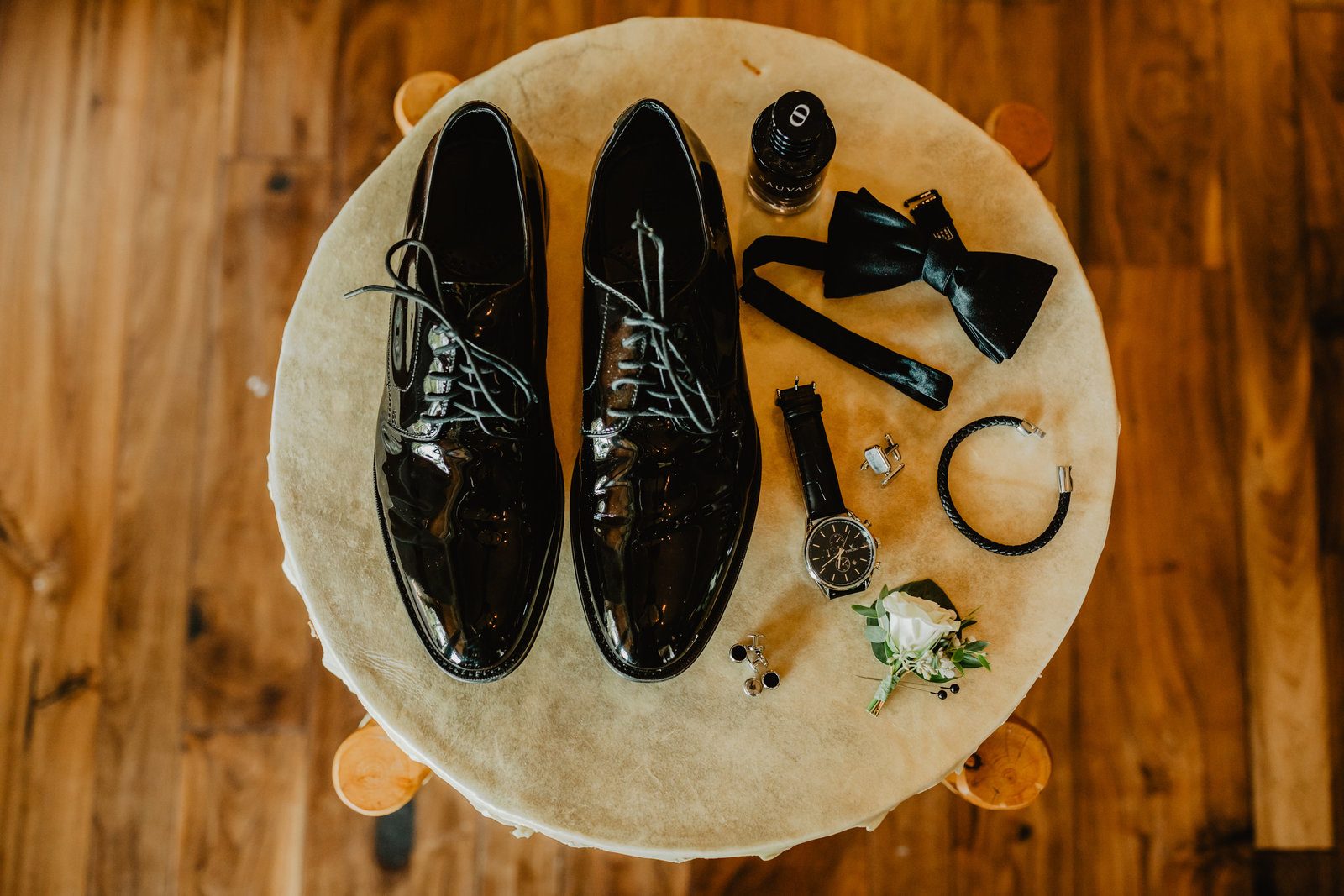 Groom details for a classic black tie wedding at Wind river