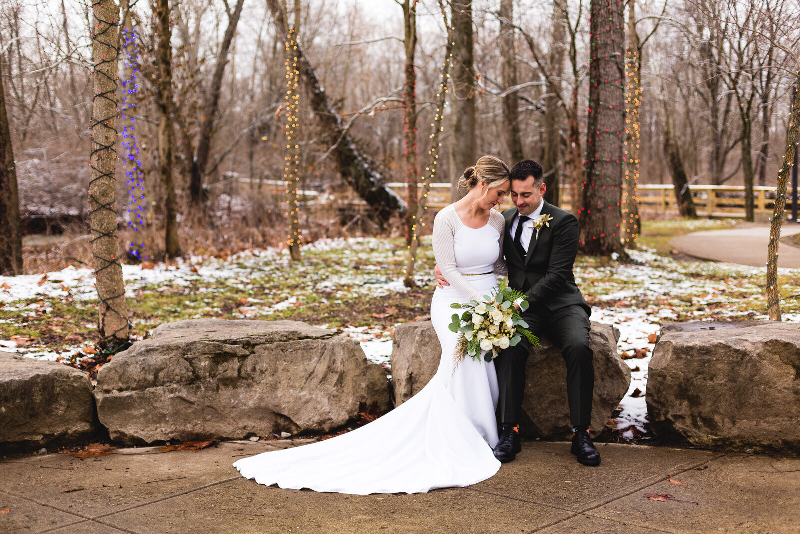 bride and groom snuggling for winter wedding portraits ohio