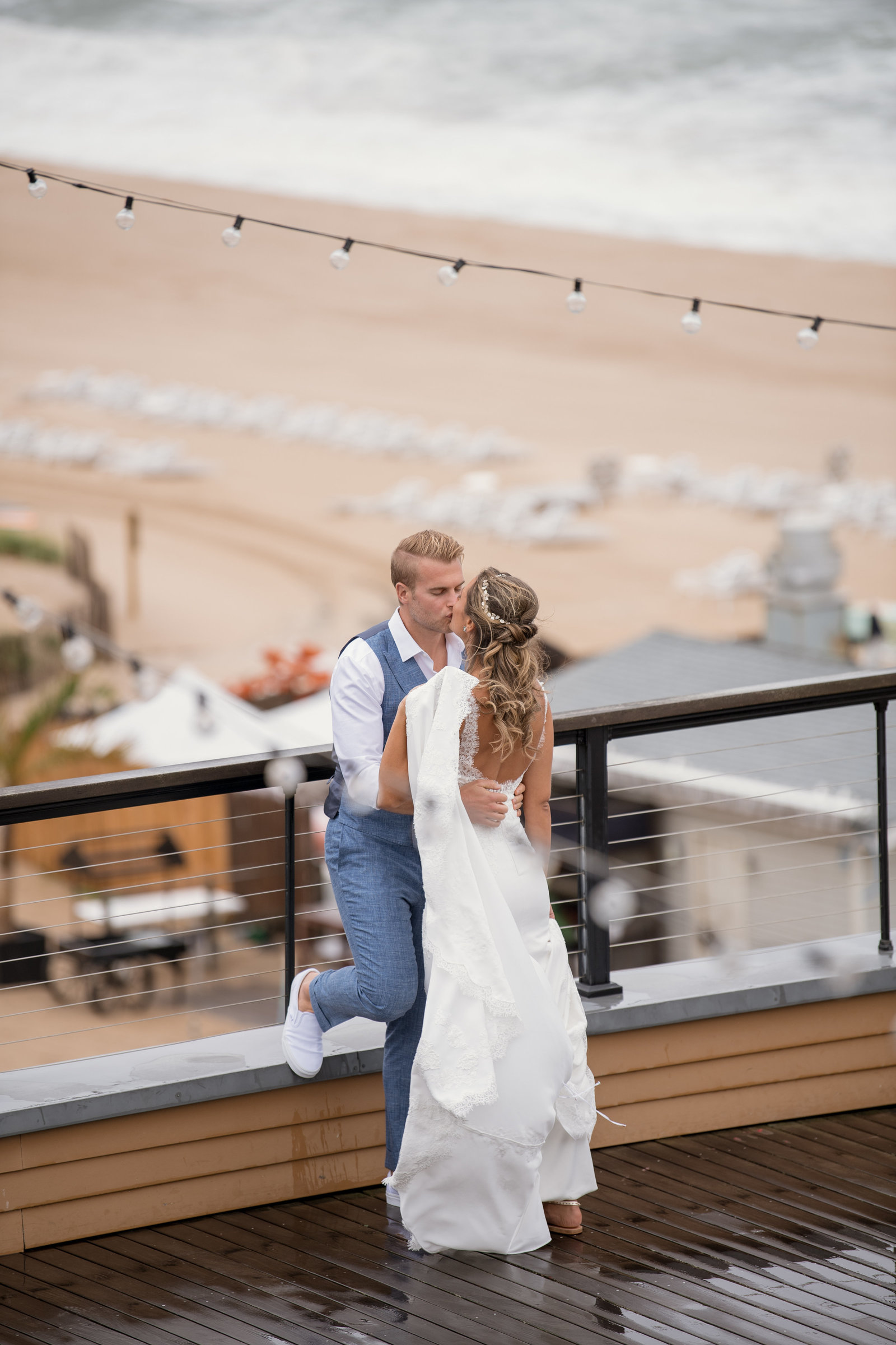 photo of bride and groom on the outside deck at Gurneys Montauk Resort wedding