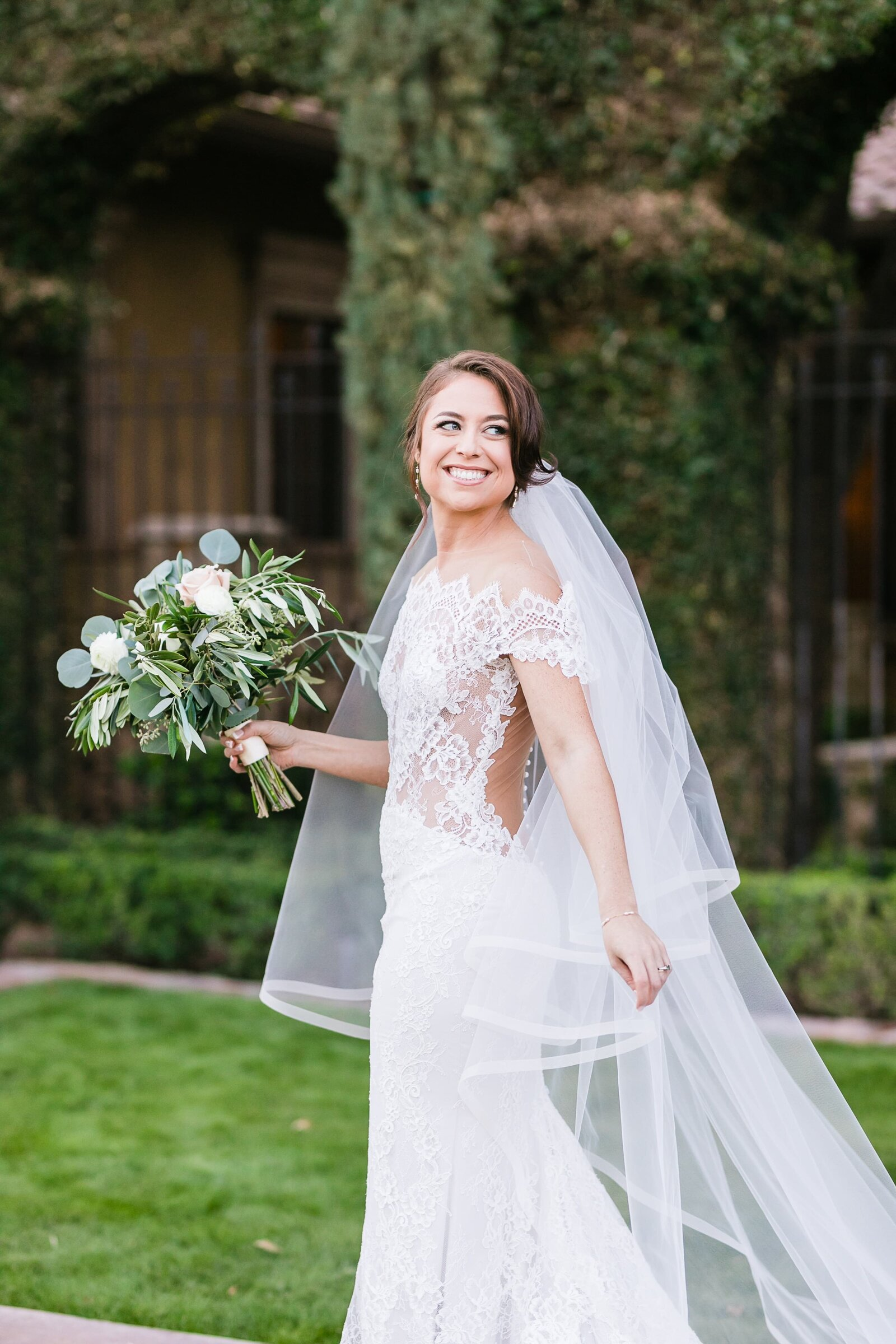 bride-looking-back-holding-veil