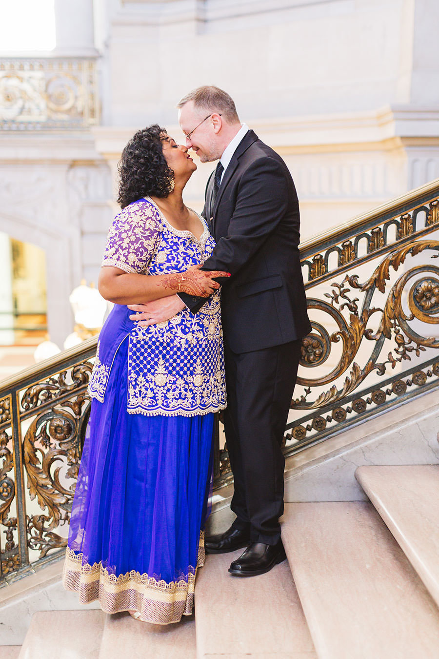 indian and american fusion wedding at san francisco city hall staircase shot