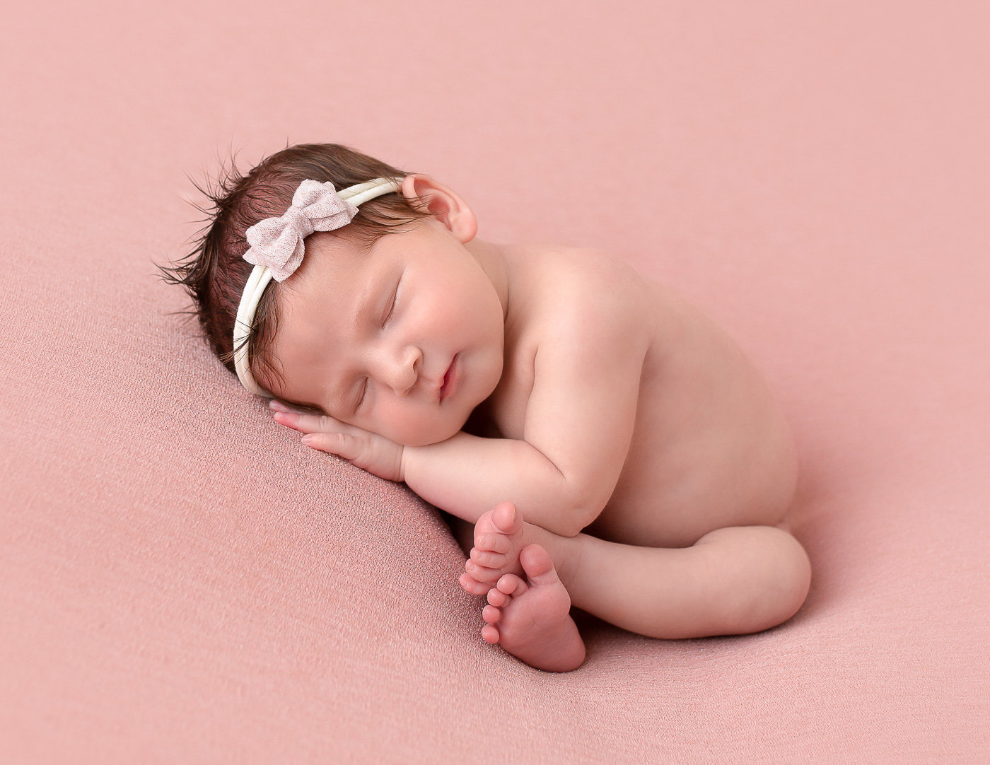 Sweet newborn girl in taco pose in Rochester NY.