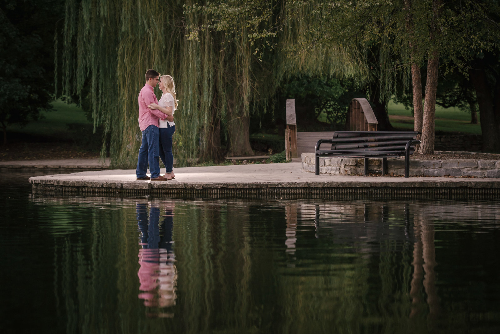 couple kissing by water in Kansas City