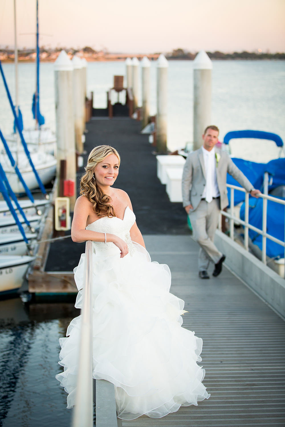 cute bride on dock with groom