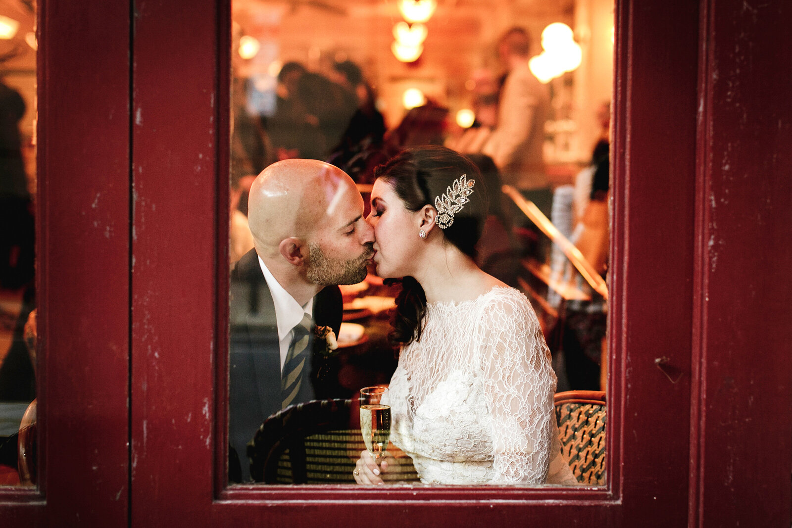 romantic couple kissing in restaurant window
