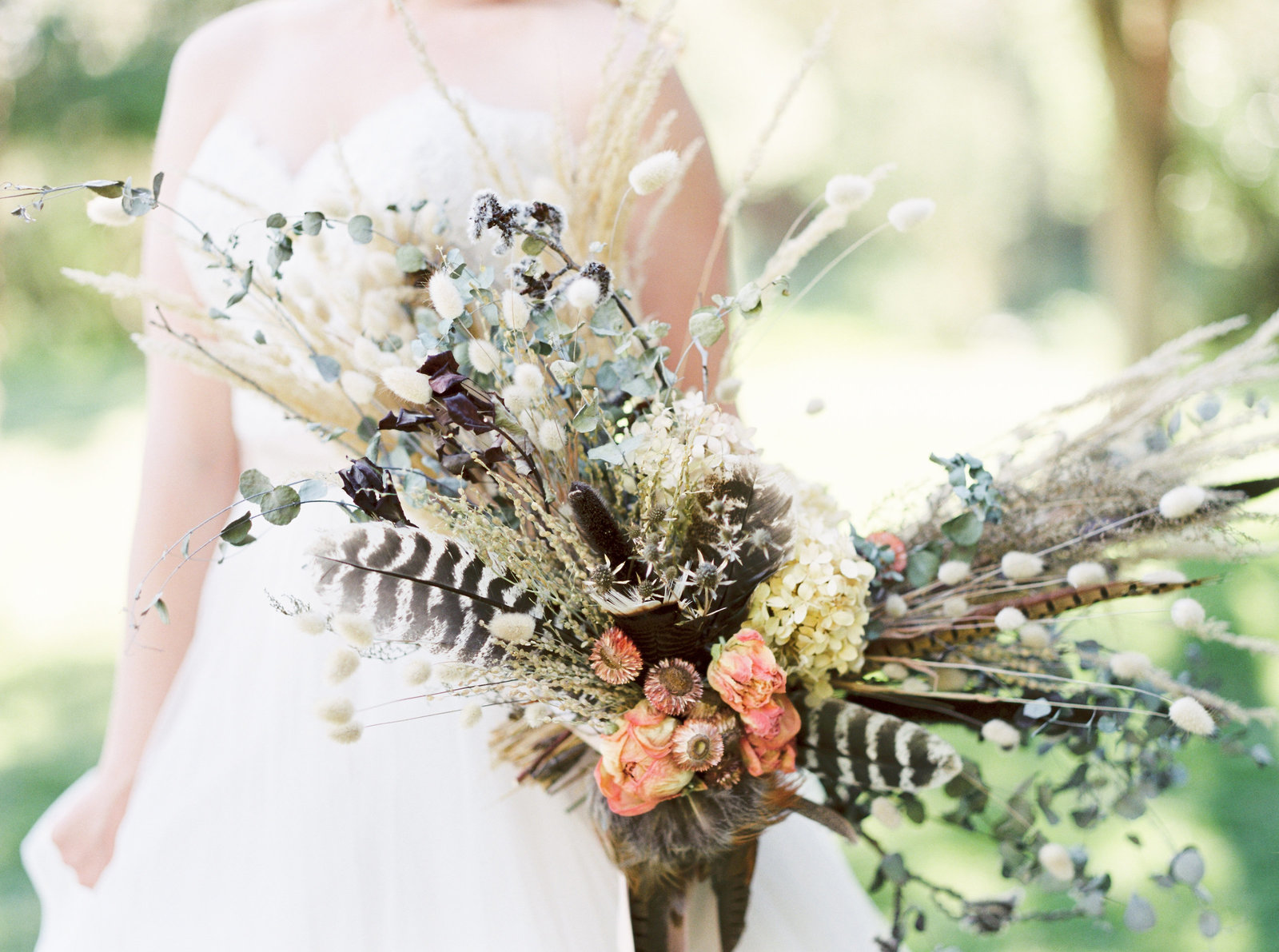 dried flower wedding bouquet with feathers