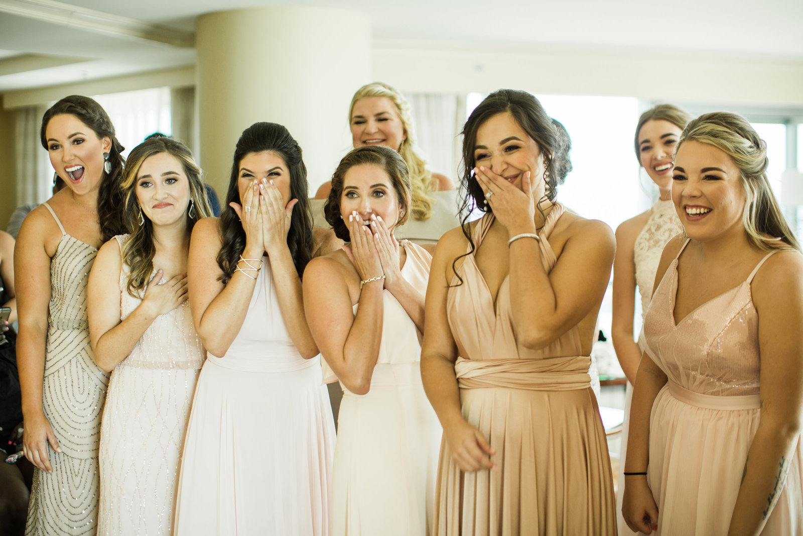 first look with bridesmaids in mismatched neutrals