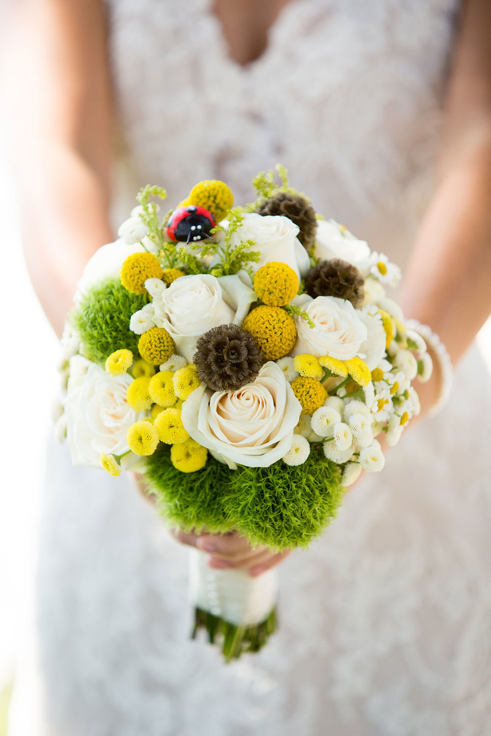 beautiful bouquet with greens yellows and white