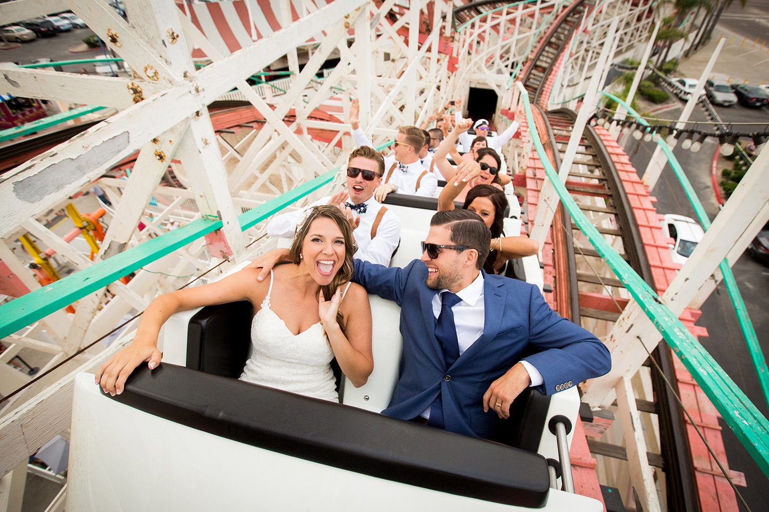 Big Dipper Mission Beach wedding photos bride and groom on coaster