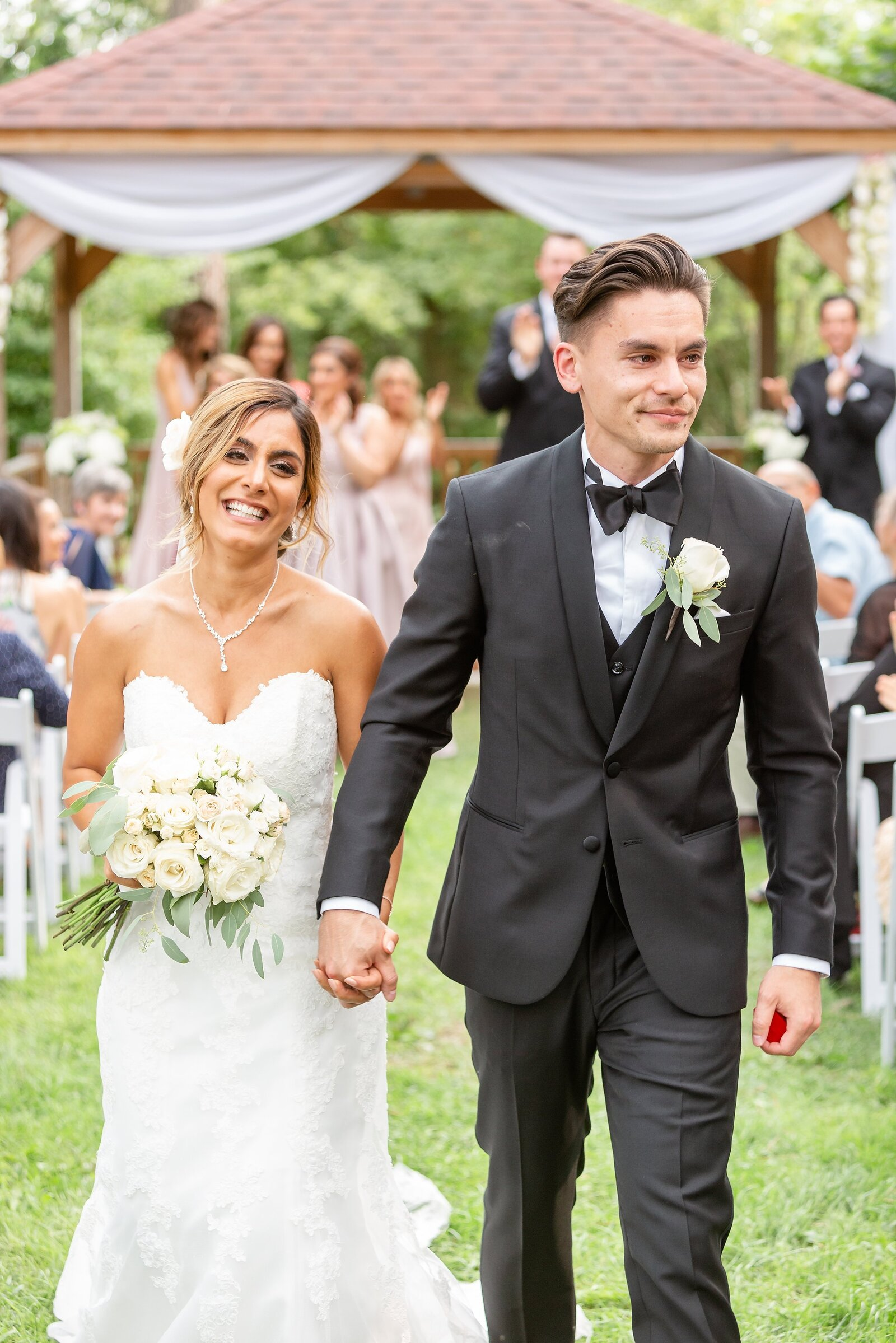Bride-and-groom-walk-down-the-aisle-as-husband-and-wife-after-their-wedding-ceremony-at-Elsie-Perrin-Williams-Estate