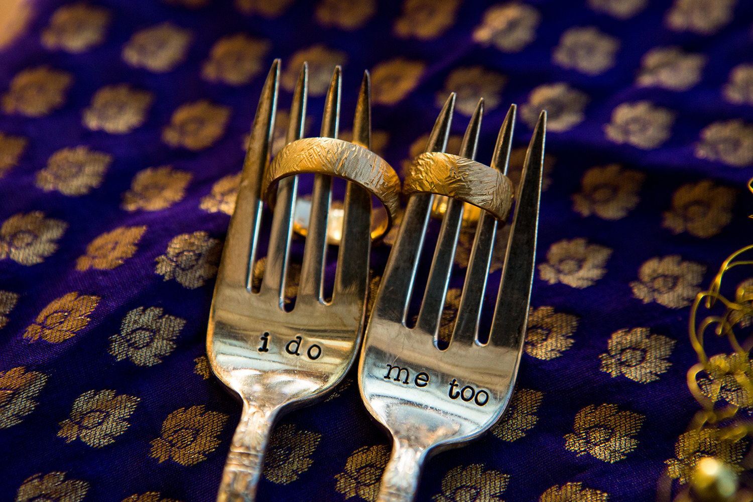 Creative ring detail photo using forks at an Indian wedding