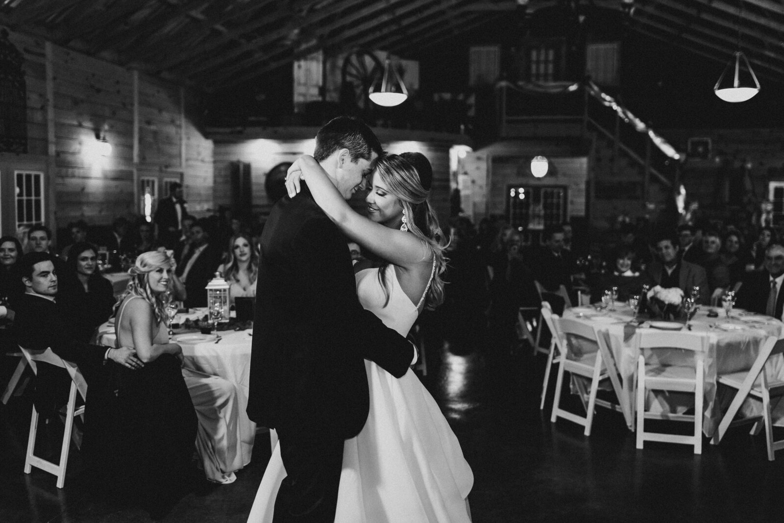 J.Michelle Photography photographs a bride and groom during their first dance at a vintage oaks farm wedding in Athens, Ga