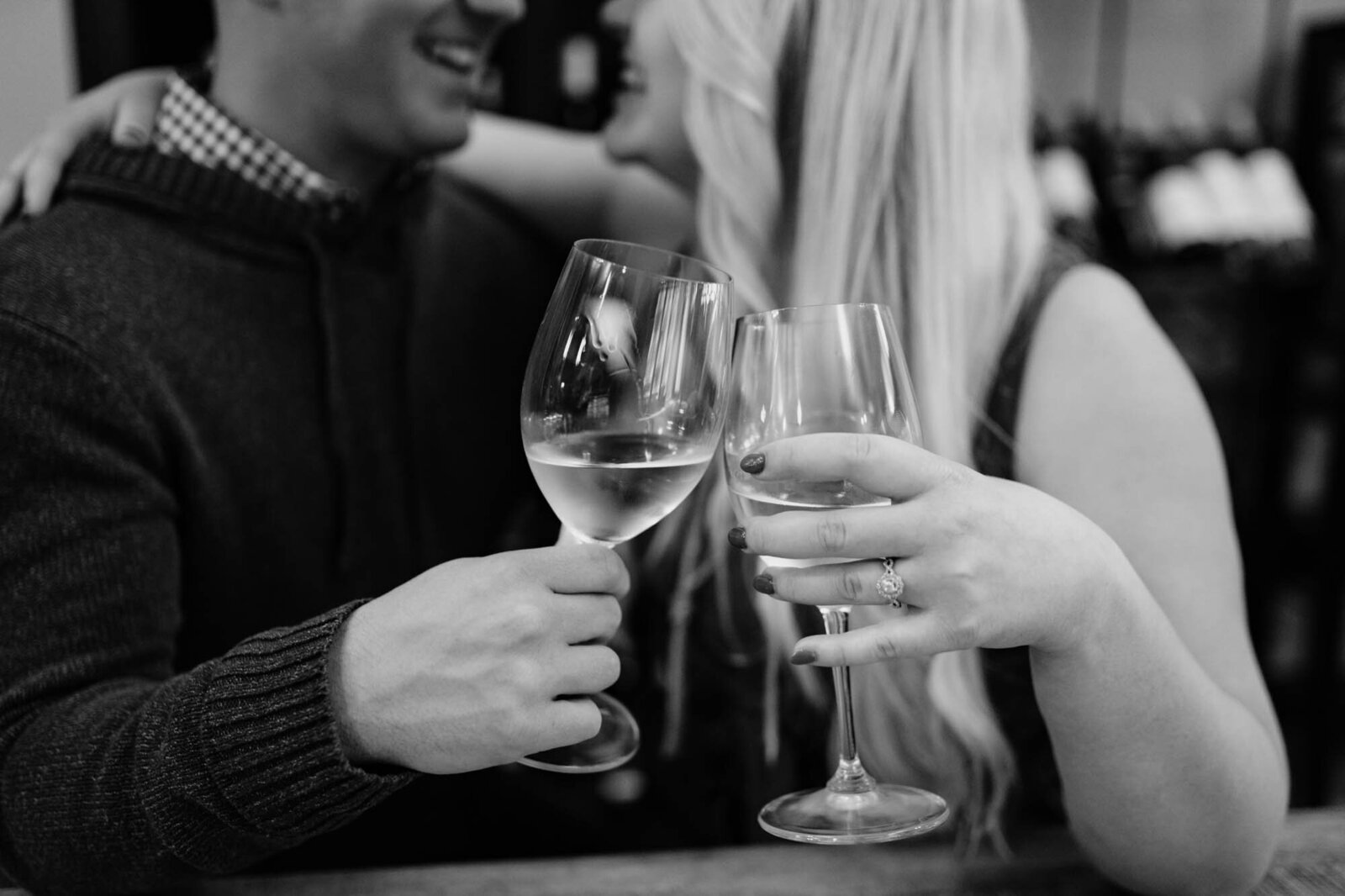 engaged couple shares wine at red door wine in lee's summit